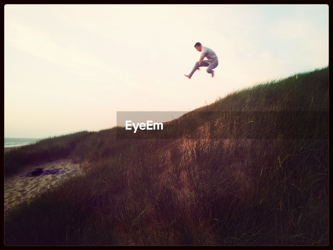 grass, full length, one person, jumping, mid-air, sunset, outdoors, nature, day, landscape, energetic, sky, people