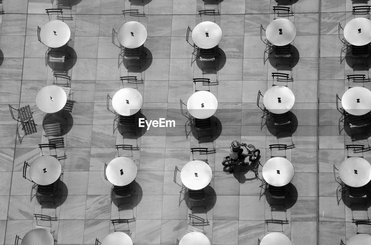 High Angle View Of Empty Tables And Chairs Arranging At Cafe