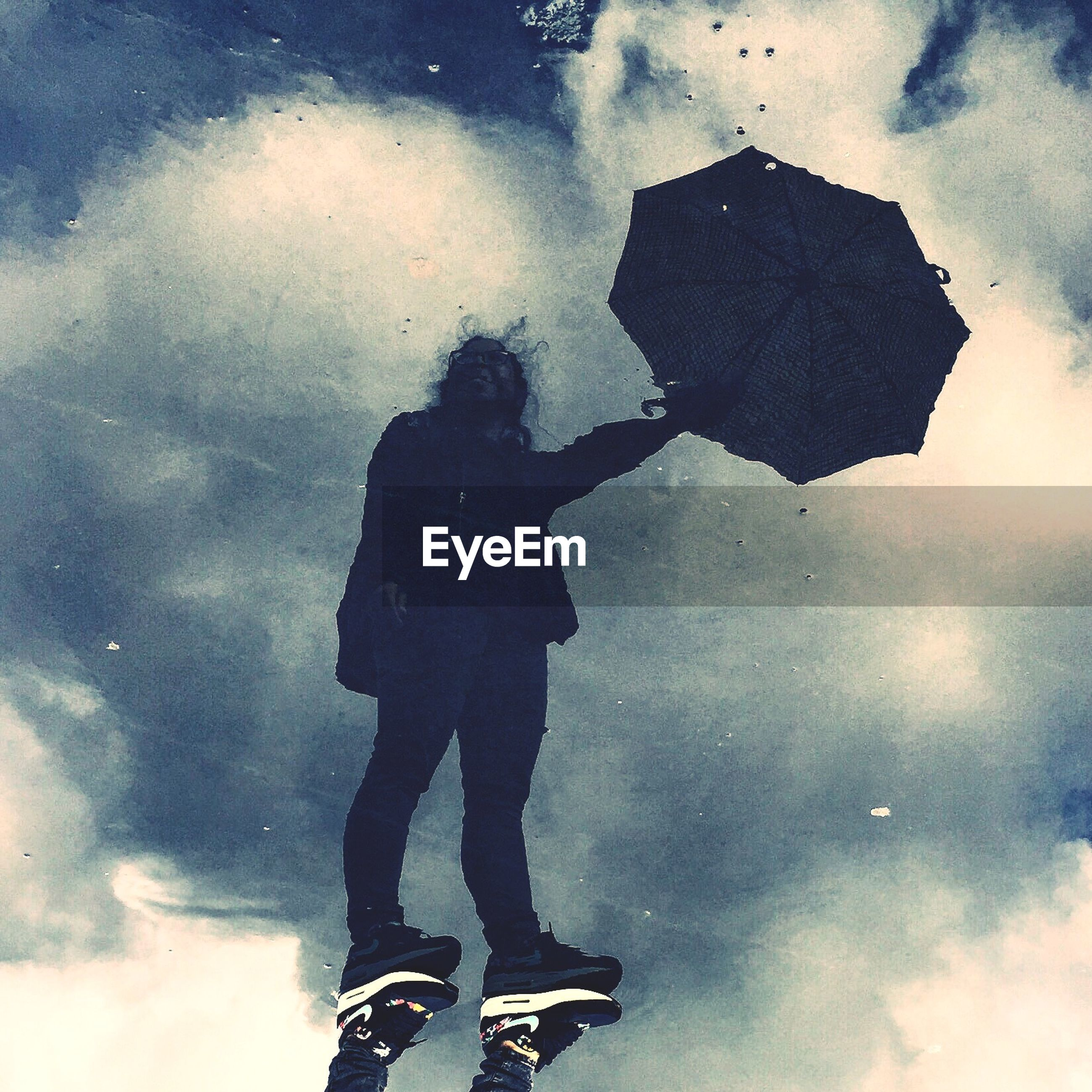 lifestyles, puddle, leisure activity, standing, men, water, low section, reflection, person, weather, high angle view, wet, season, street, unrecognizable person, silhouette, rain, cloud - sky
