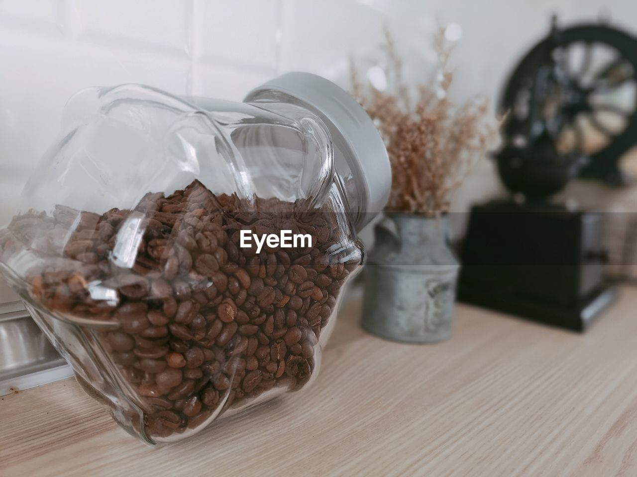 table, indoors, container, food and drink, still life, food, jar, freshness, roasted coffee bean, no people, close-up, glass - material, coffee, coffee - drink, transparent, brown, focus on foreground, large group of objects, bag, abundance, plastic bag, temptation
