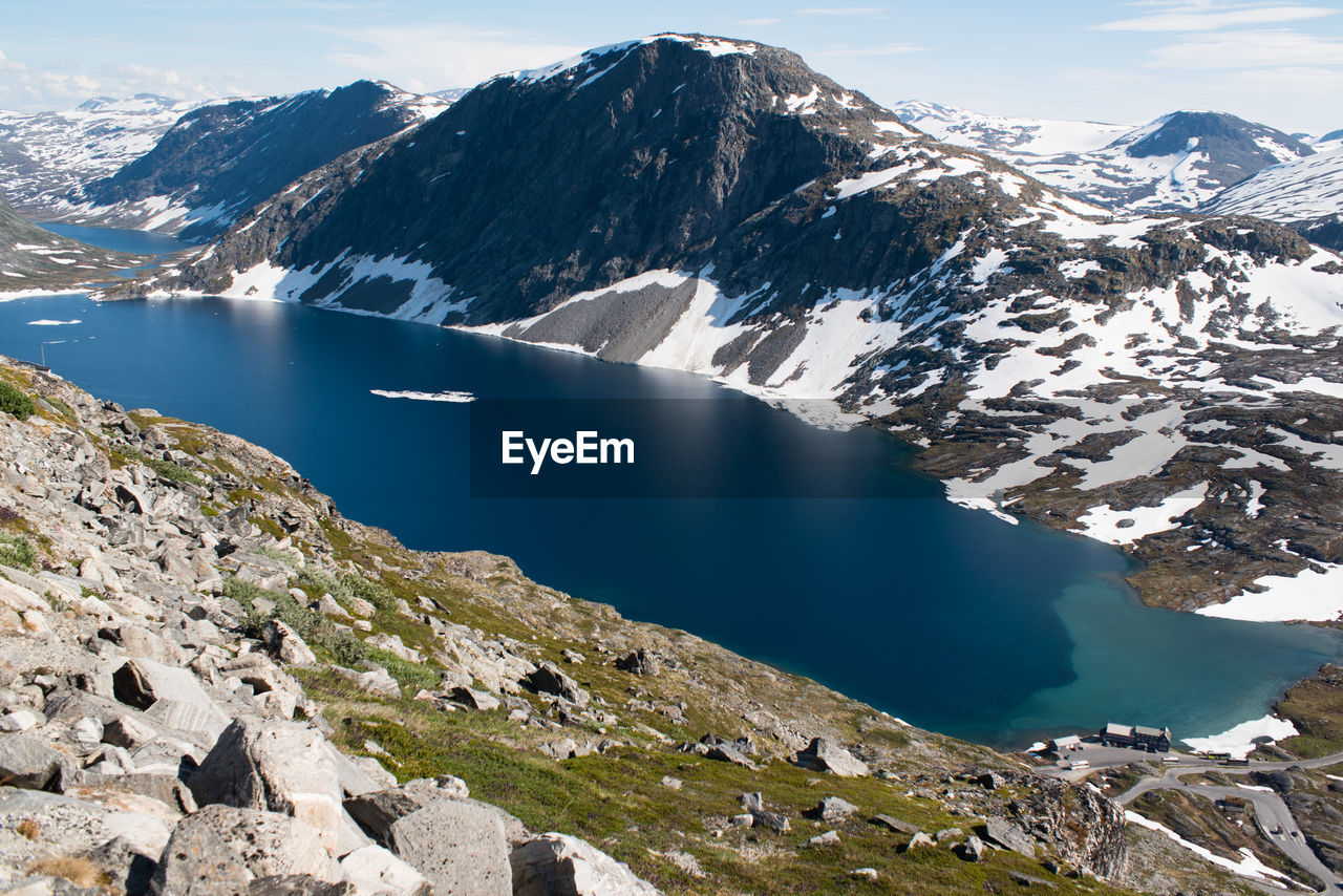 SCENIC VIEW OF LAKE BY SNOWCAPPED MOUNTAIN