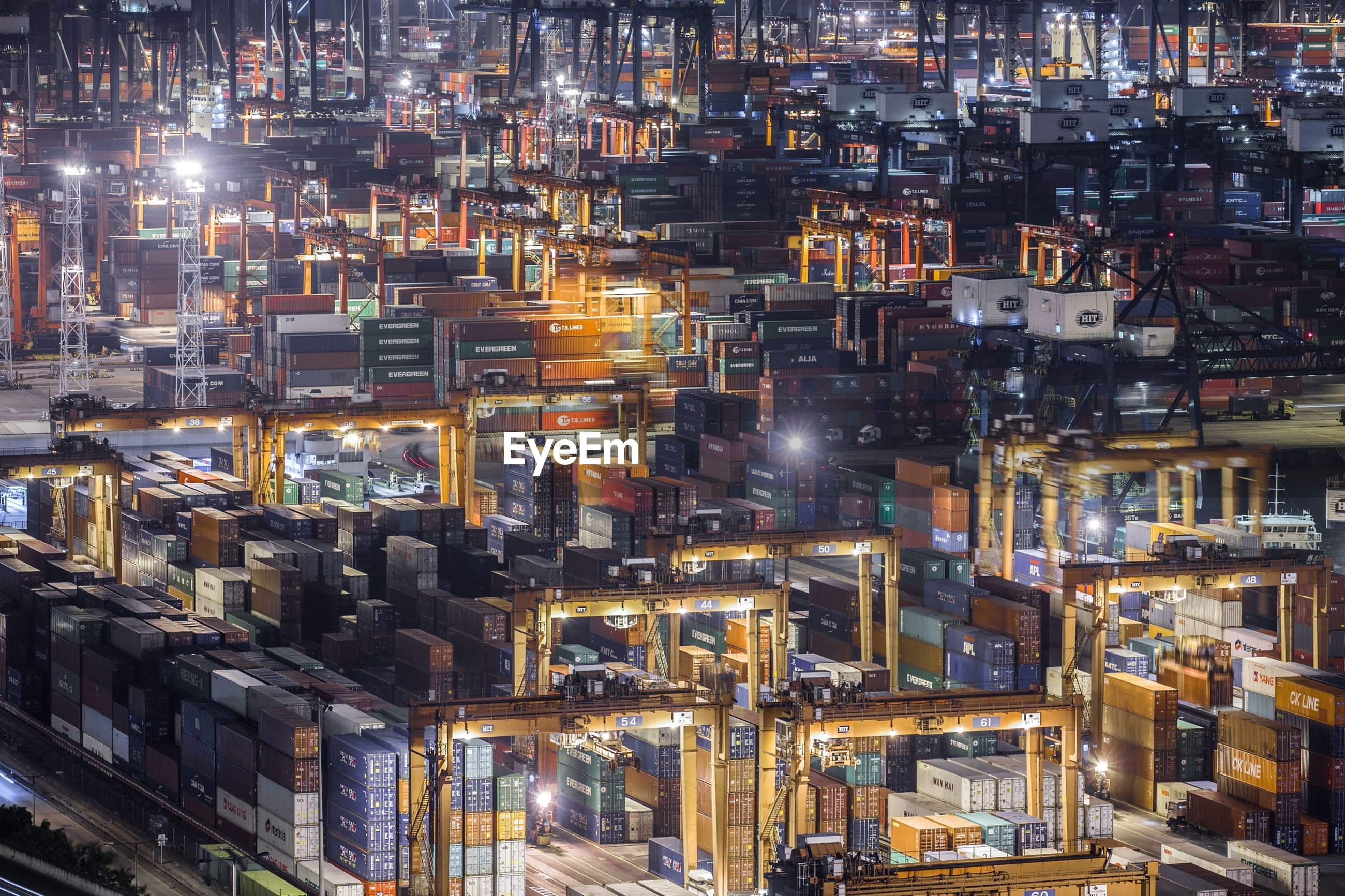 High angle view of illuminated cargo containers at commercial dock