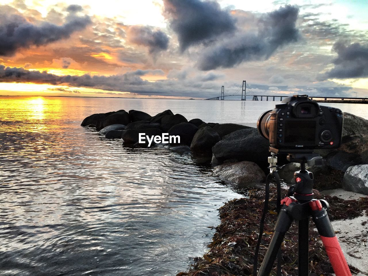 cloud - sky, water, sky, sea, sunset, nature, beauty in nature, scenics - nature, technology, no people, outdoors, photography themes, architecture, tranquil scene, transportation, camera - photographic equipment, digital camera, built structure