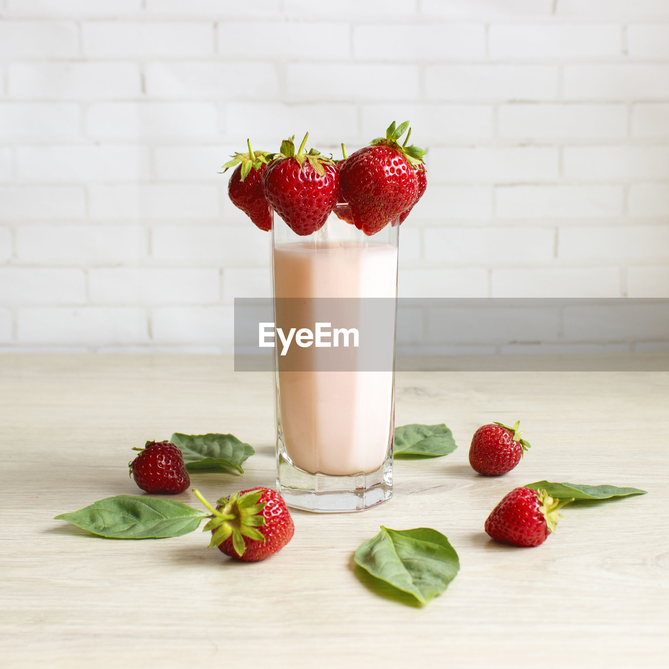 Close-up of drink with strawberries on table
