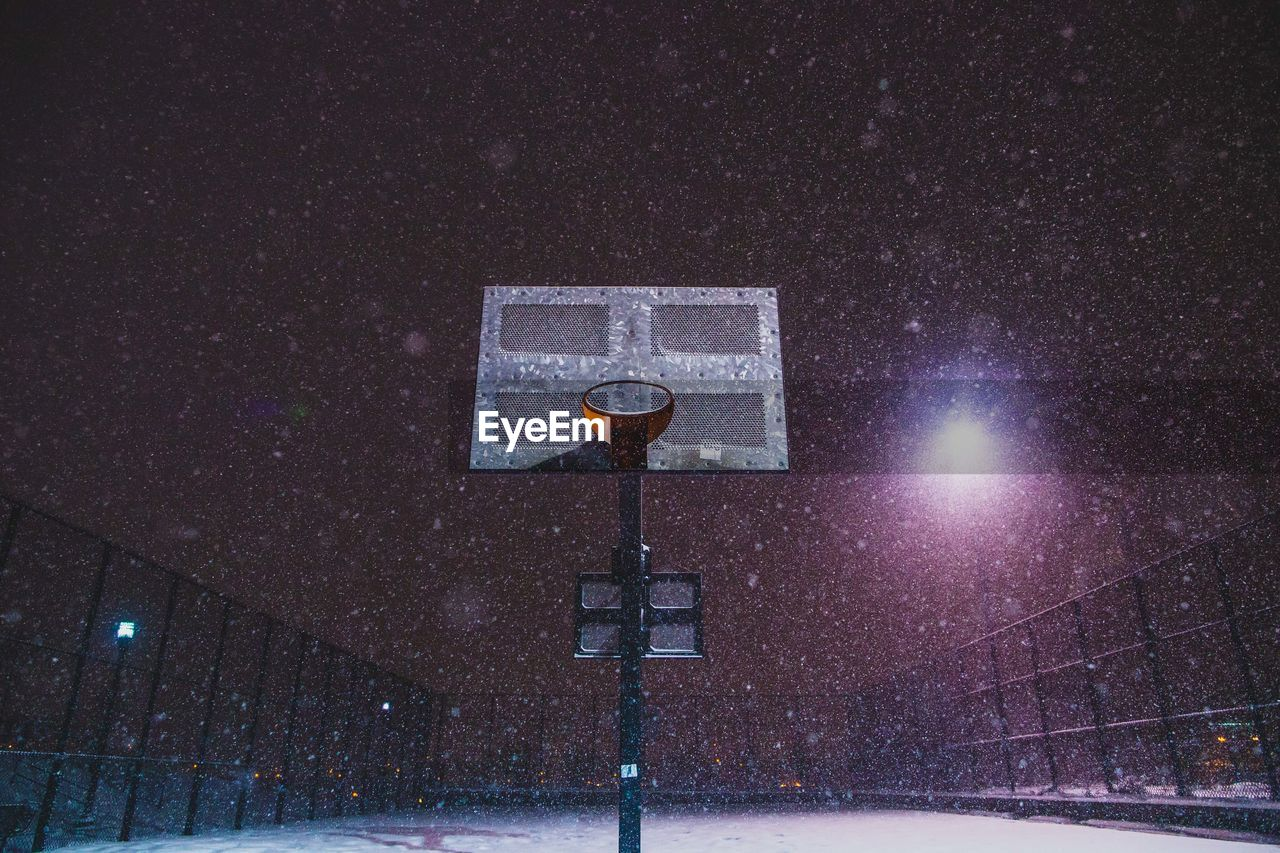 Low Angle View Of Basketball Court During Snowfall