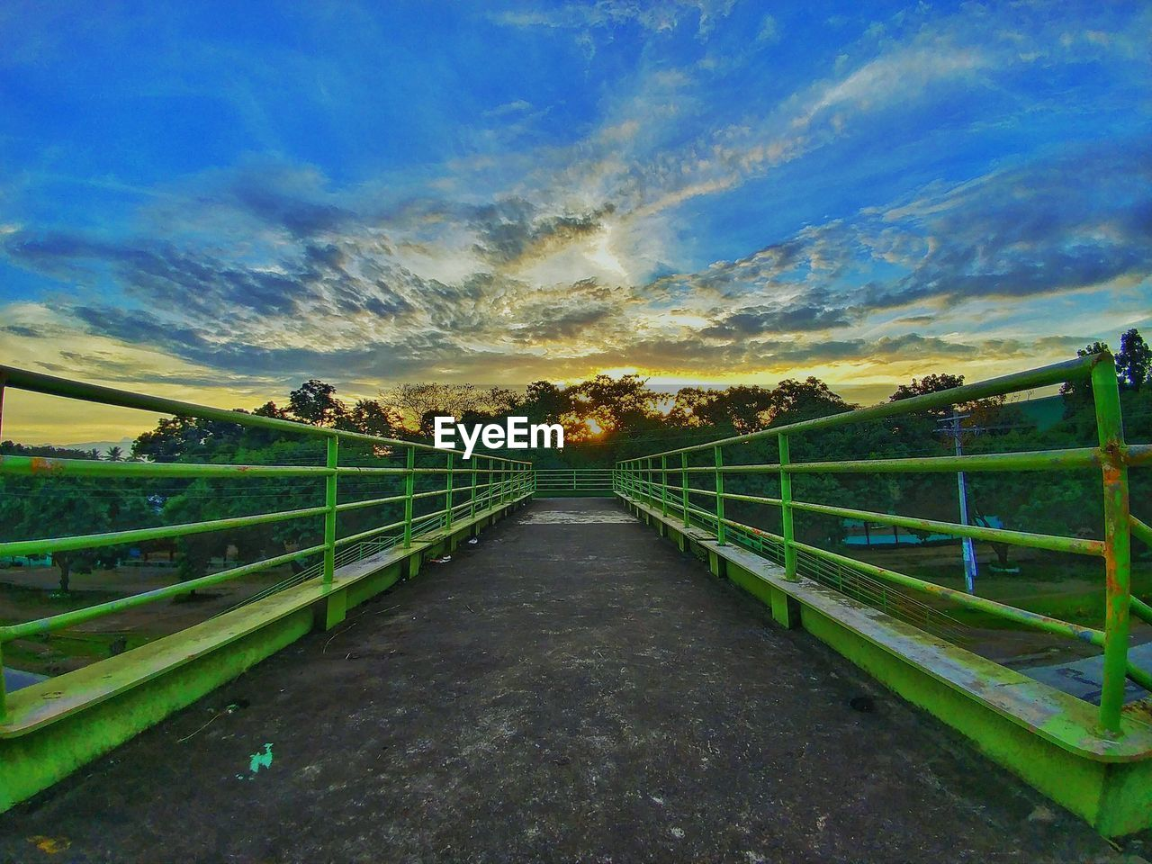 sky, tranquil scene, tranquility, scenics, nature, the way forward, railing, no people, outdoors, cloud - sky, beauty in nature, field, grass, landscape, sunset, day