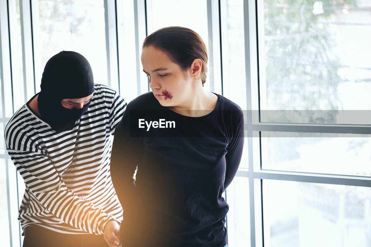 Thief Threatening Woman By Window