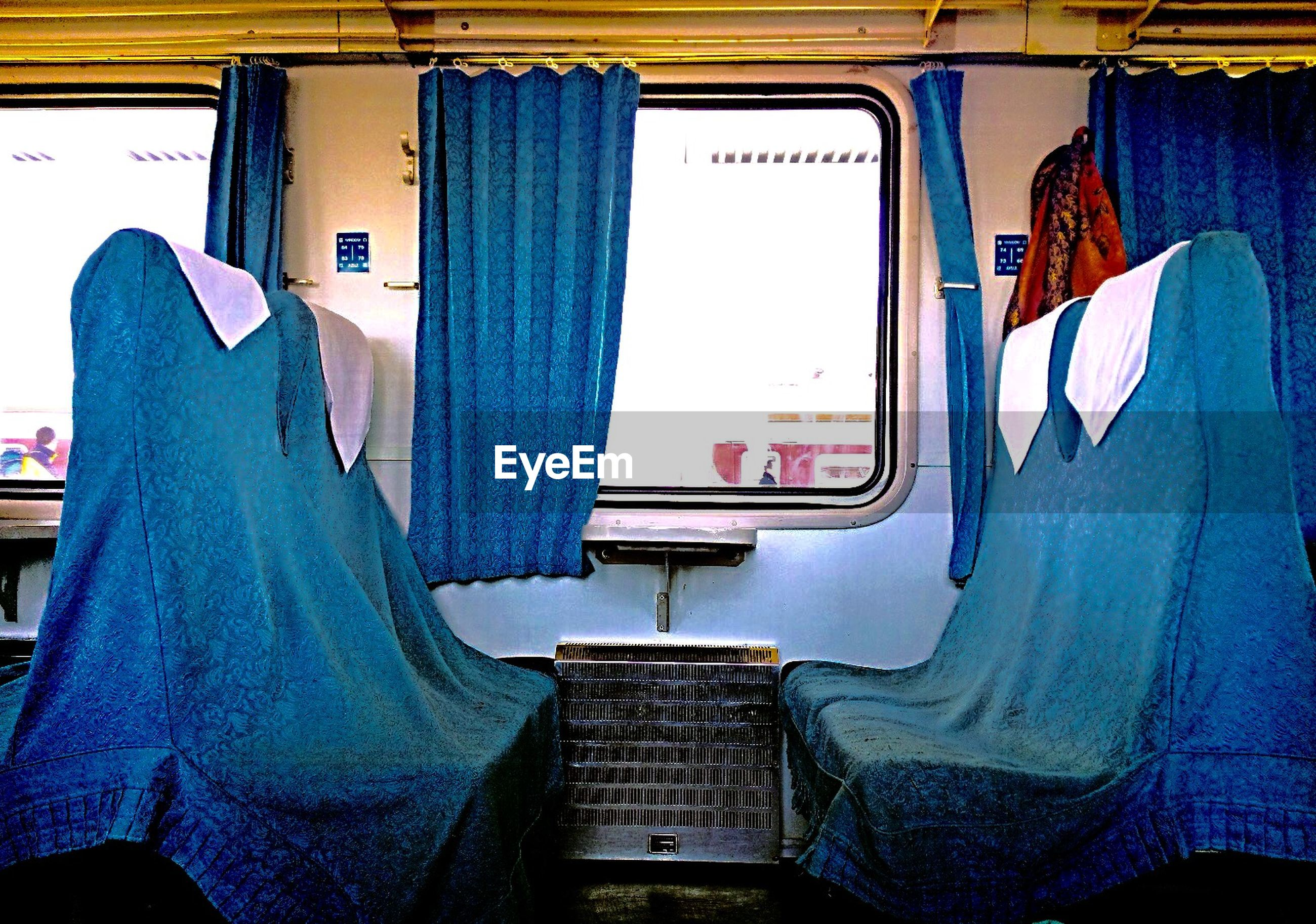 indoors, men, transportation, rear view, lifestyles, window, public transportation, mode of transport, travel, architecture, person, casual clothing, standing, built structure, train - vehicle, sitting, vehicle interior, day