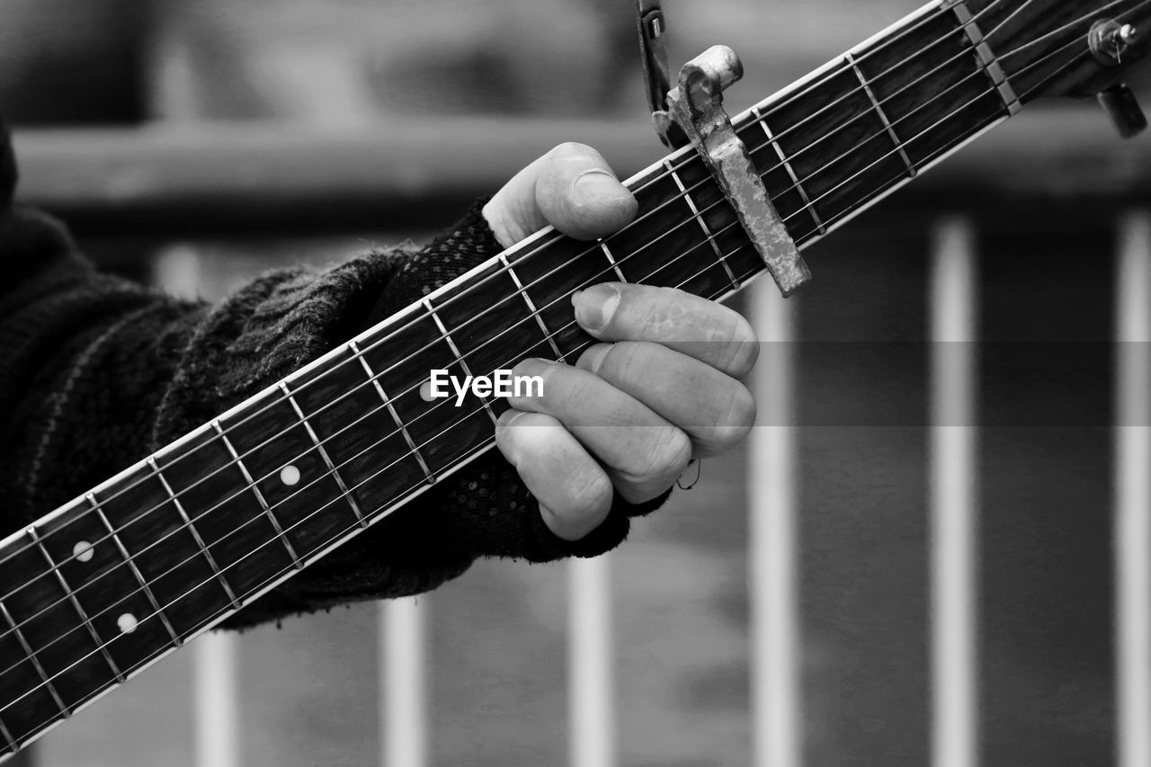 Cropped Image Of Person Playing Guitar