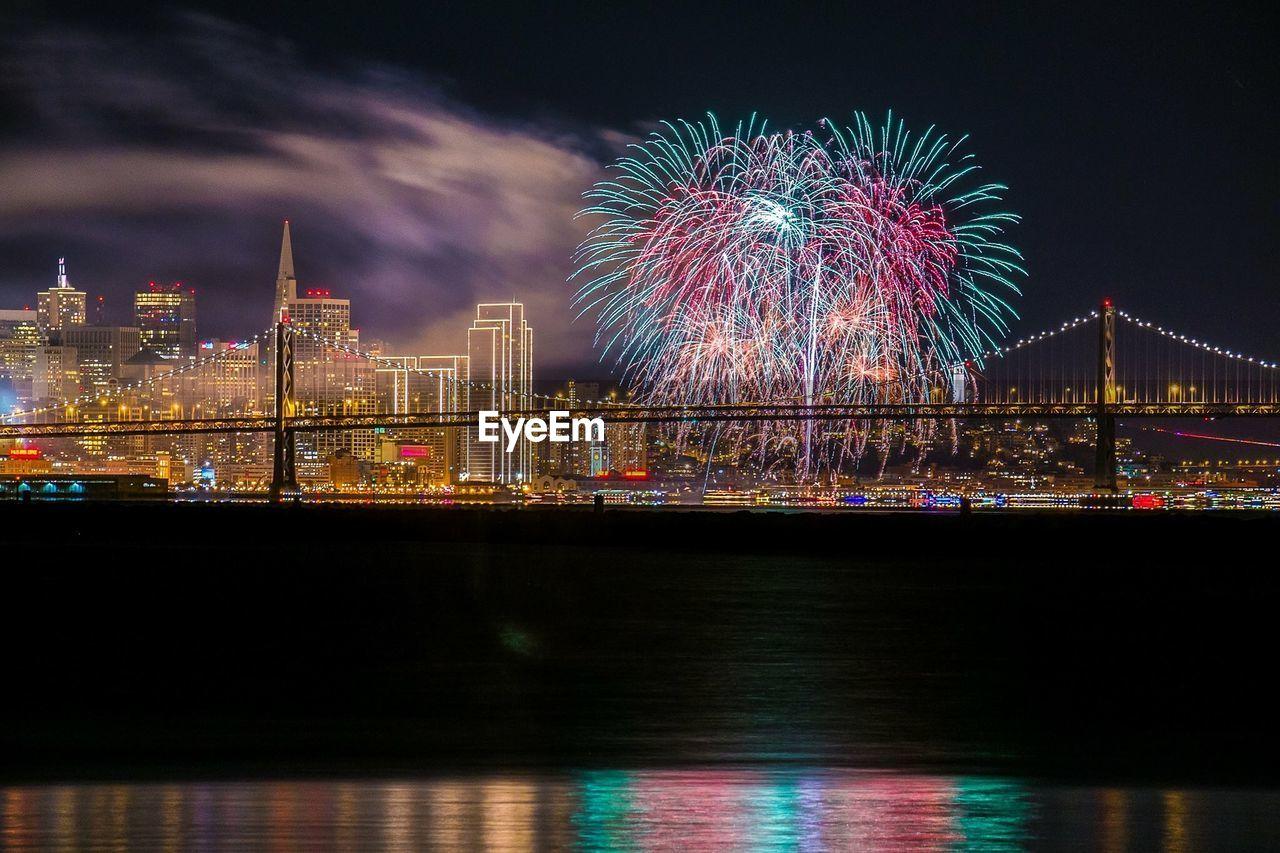 Firework Display And Illuminated Cityscape By San Francisco–Oakland Bay Bridge