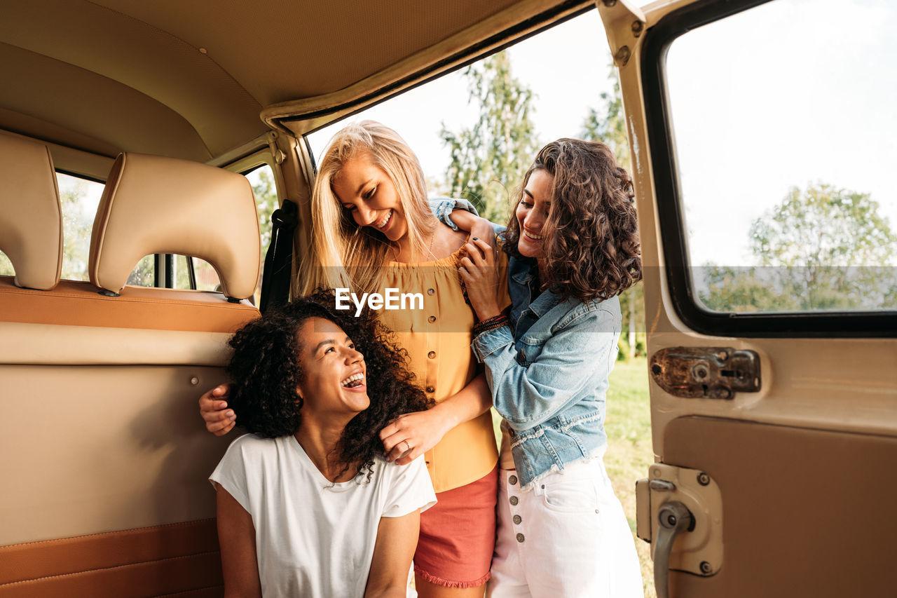 Group of female friends in camping van