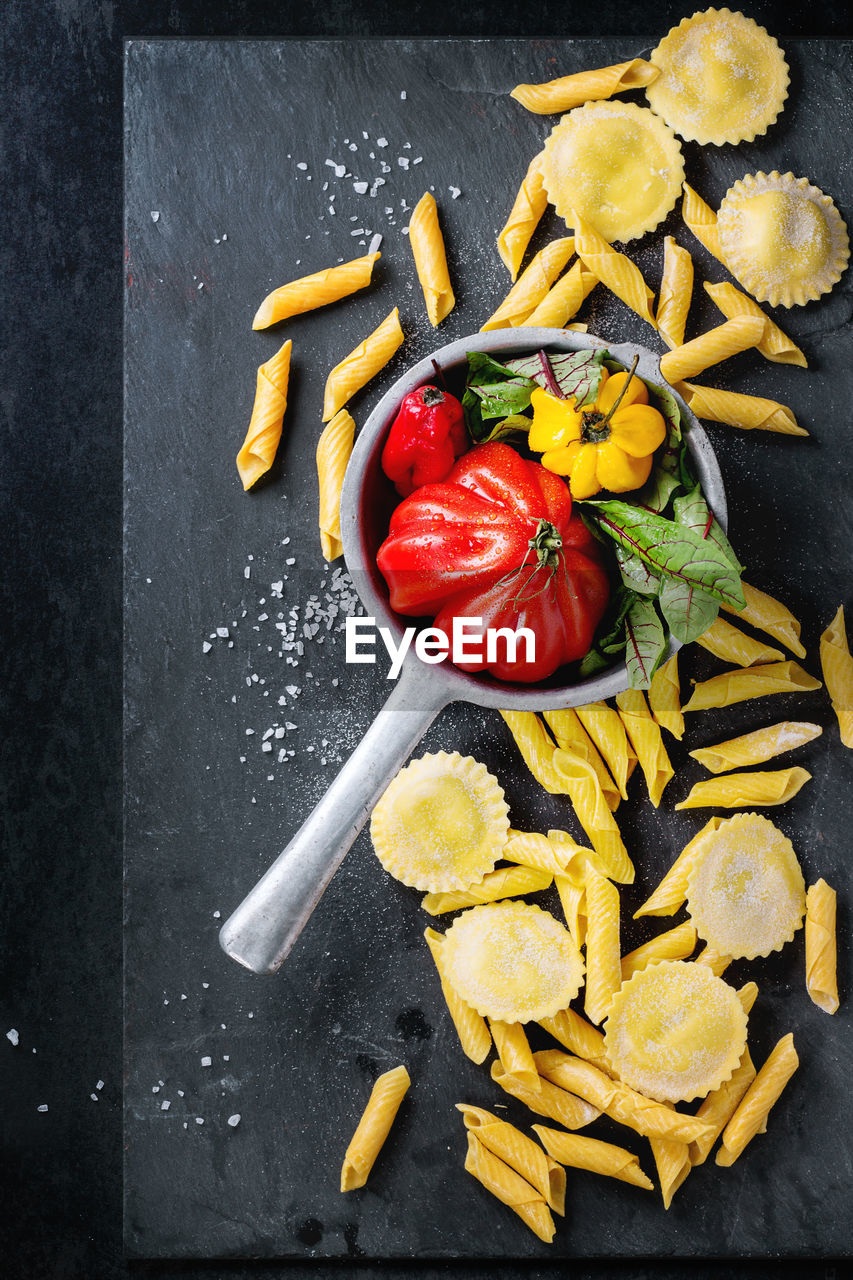 Top View Of Pasta And Vegetables On Black Background