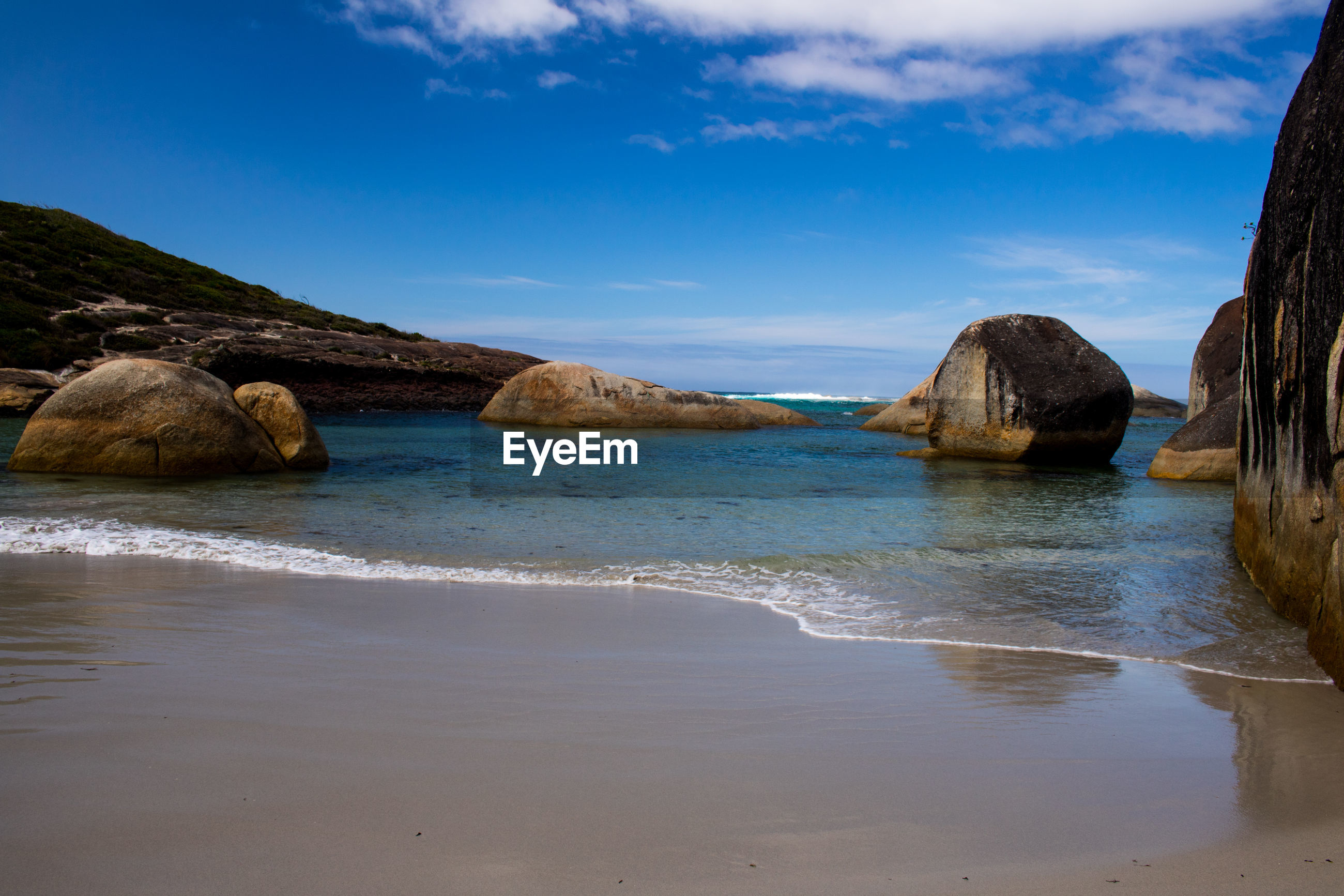 SCENIC VIEW OF SEA WITH ROCKS IN BACKGROUND