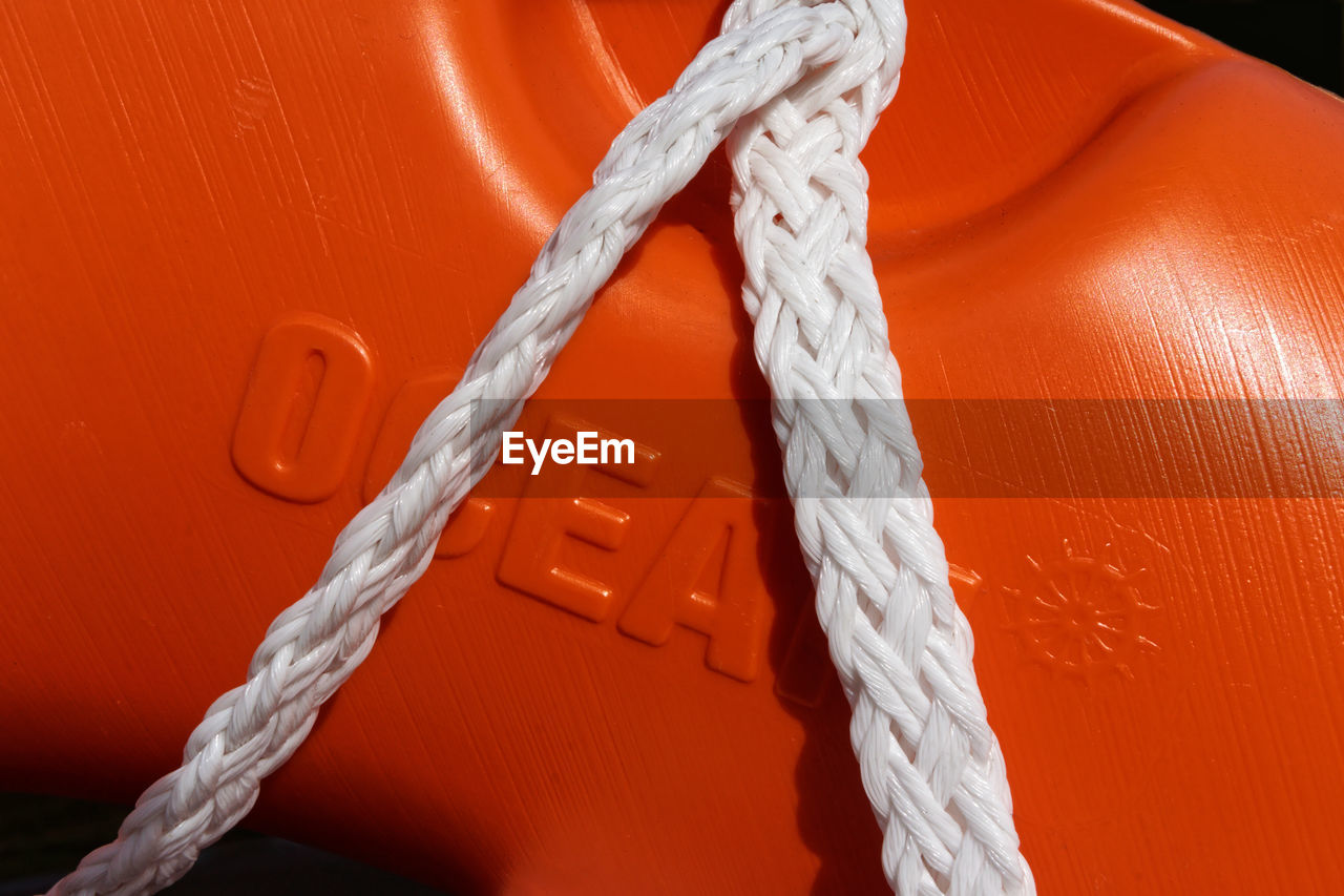 rope, strength, white color, tied knot, no people, orange color, close-up, durability, tied up, connection, indoors, still life, pattern, red, nautical vessel, wall - building feature, wood - material, day, number