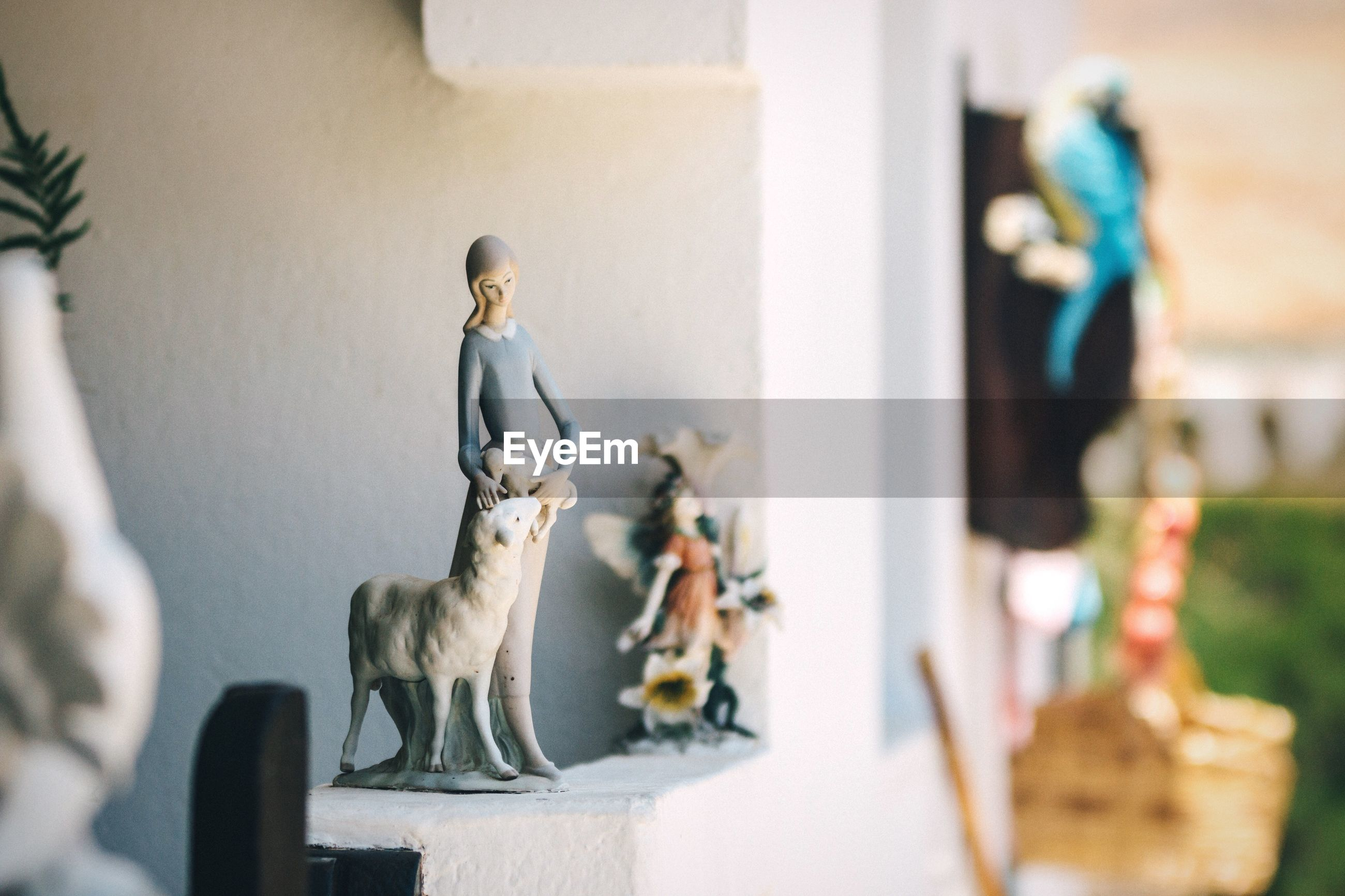 Close-up of figurines at home