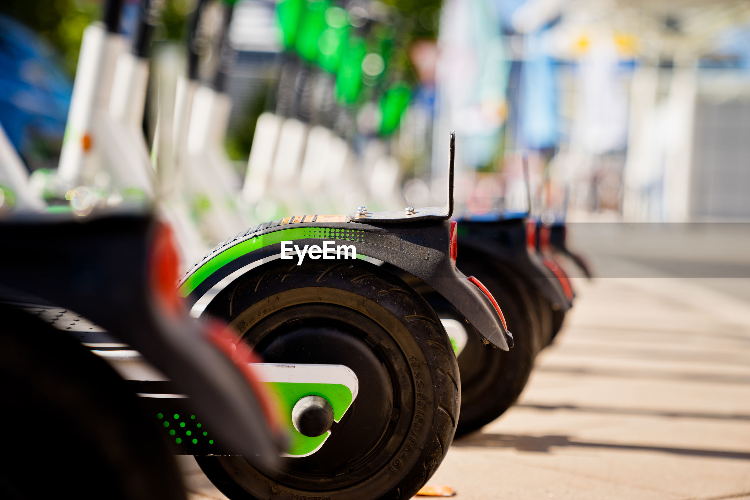 Close-up of electric push scooters