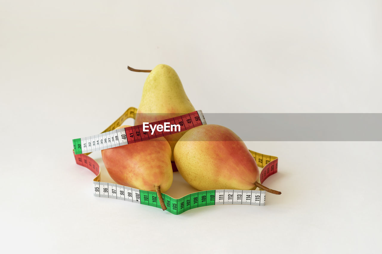 food, studio shot, still life, food and drink, white background, fruit, indoors, freshness, healthy eating, wellbeing, close-up, no people, copy space, group of objects, pear, cut out, high angle view, banana, yellow, healthy lifestyle, dieting, ripe, small group of objects