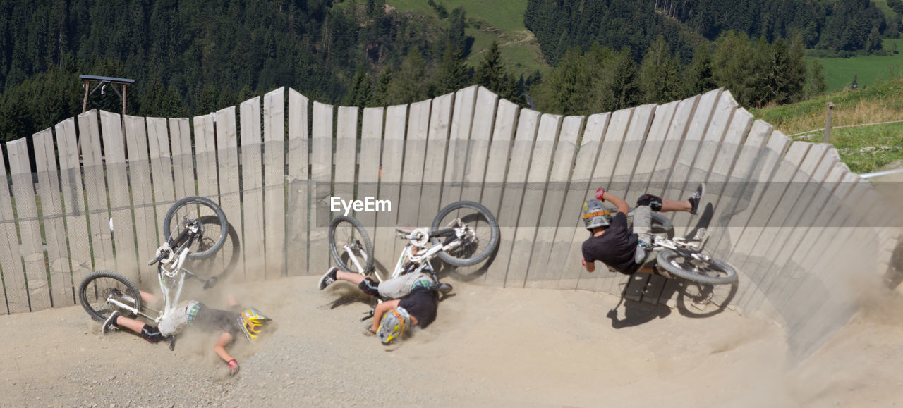 group of people, men, high angle view, day, transportation, real people, nature, helmet, full length, headwear, motorcycle, people, land vehicle, outdoors, sport, occupation, mountain, risk, tree, riding
