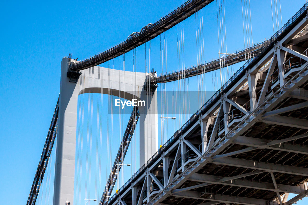 connection, bridge - man made structure, architecture, low angle view, built structure, engineering, transportation, day, outdoors, blue, suspension bridge, no people, travel destinations, sky, clear sky
