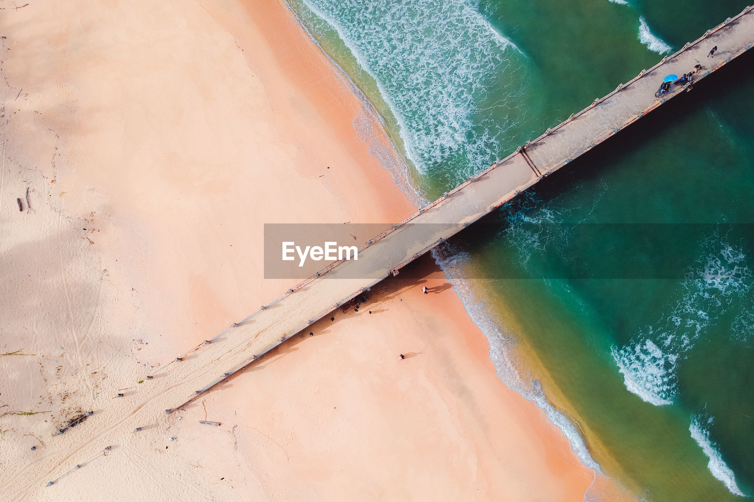 Aerial view of jetty on beach