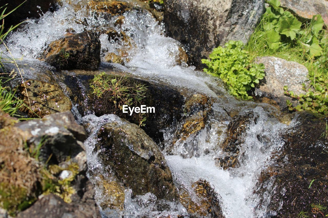 rock - object, water, motion, nature, no people, beauty in nature, high angle view, waterfall, outdoors, day, scenics, power in nature