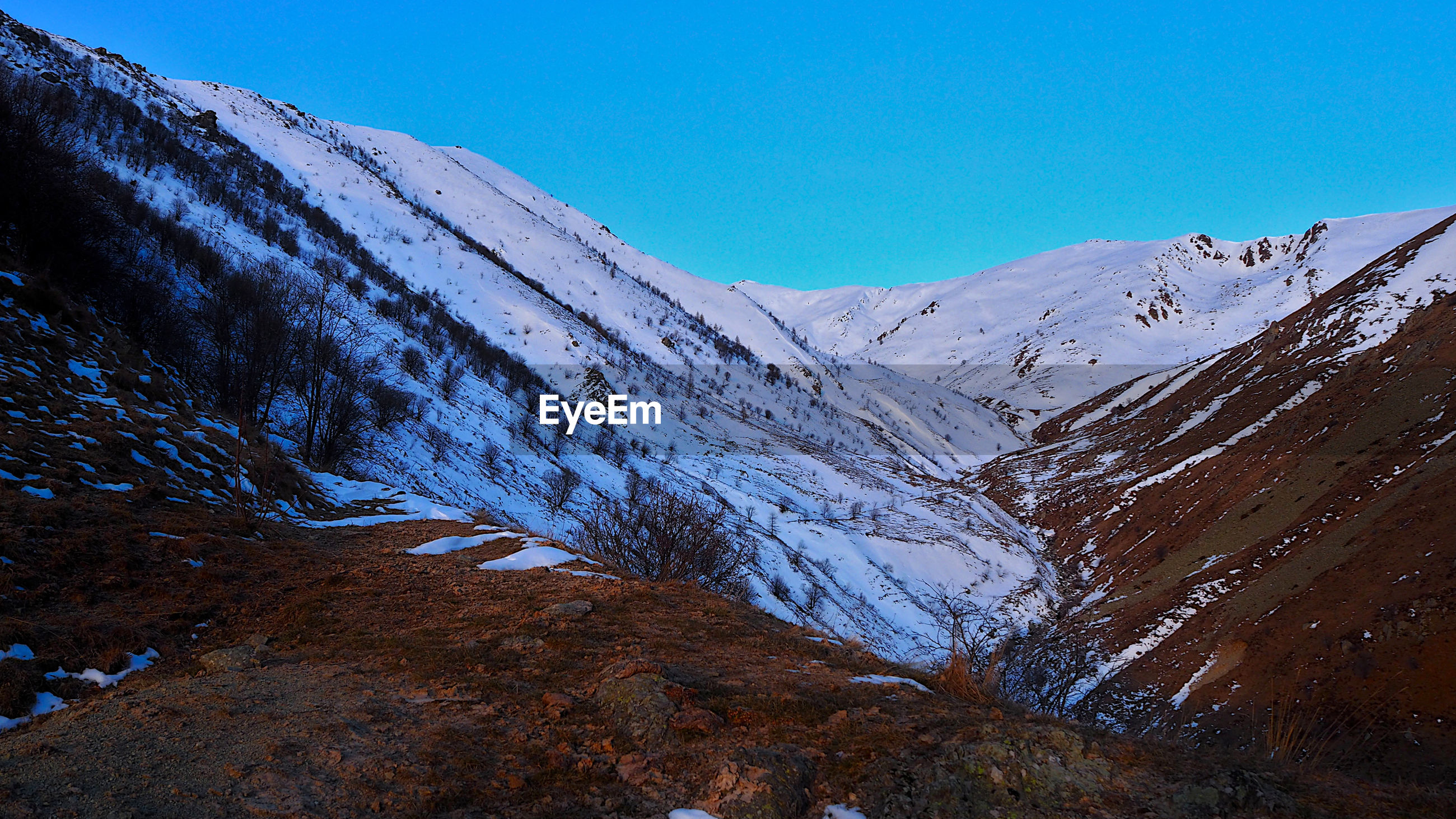 Scenic view of snowcapped mountains against clear blue sky, northern side of pizzo d'ormea