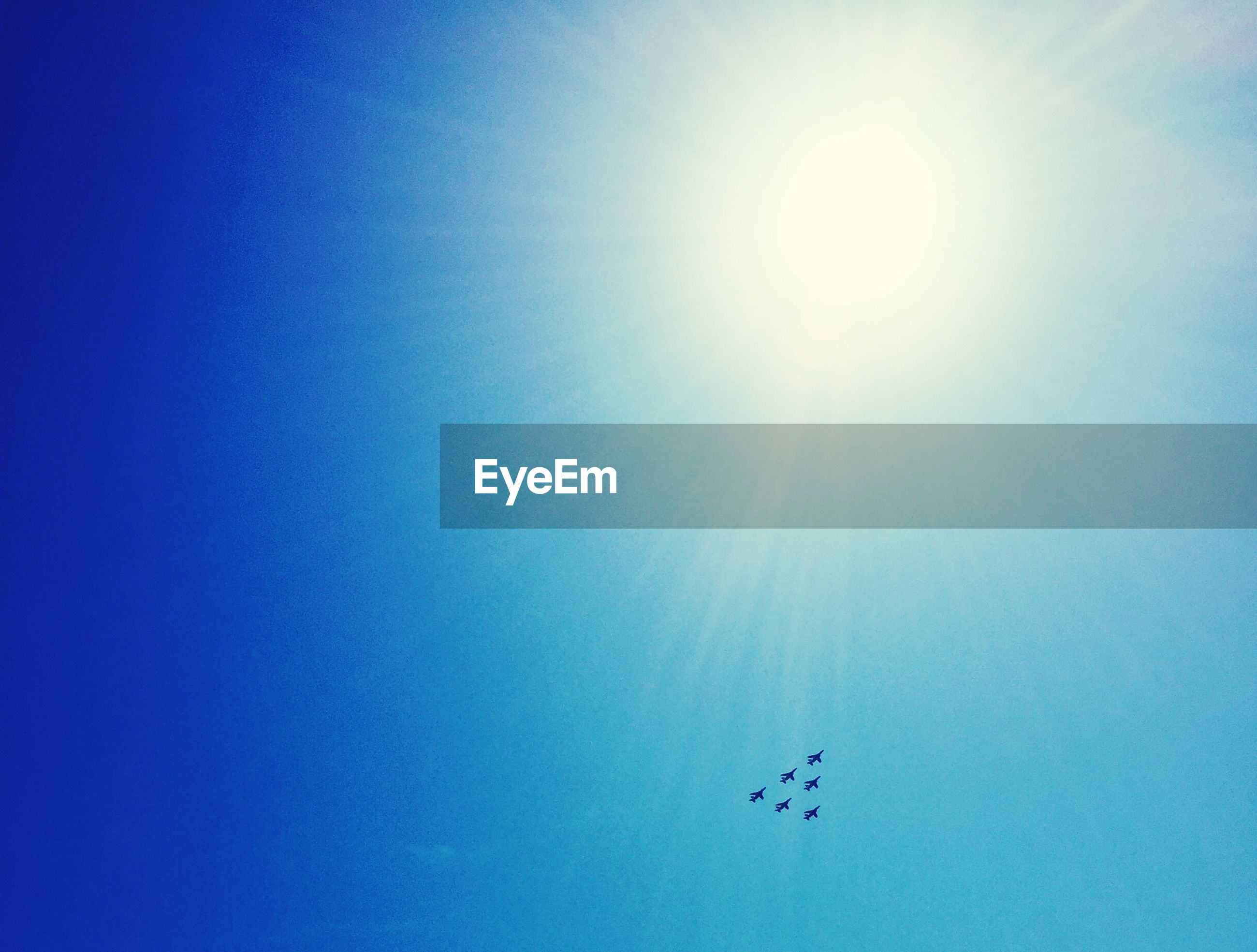 blue, low angle view, sun, clear sky, sunlight, copy space, sunbeam, bright, sunny, lens flare, nature, beauty in nature, day, tranquility, outdoors, no people, sky, scenics, vapor trail, tranquil scene