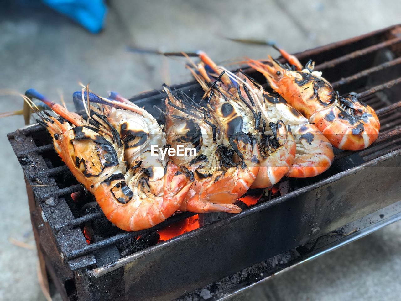 food, food and drink, barbecue, seafood, freshness, barbecue grill, heat - temperature, healthy eating, grilled, wellbeing, no people, preparation, high angle view, close-up, burning, crustacean, day, fire, meat, fire - natural phenomenon, outdoors, preparing food