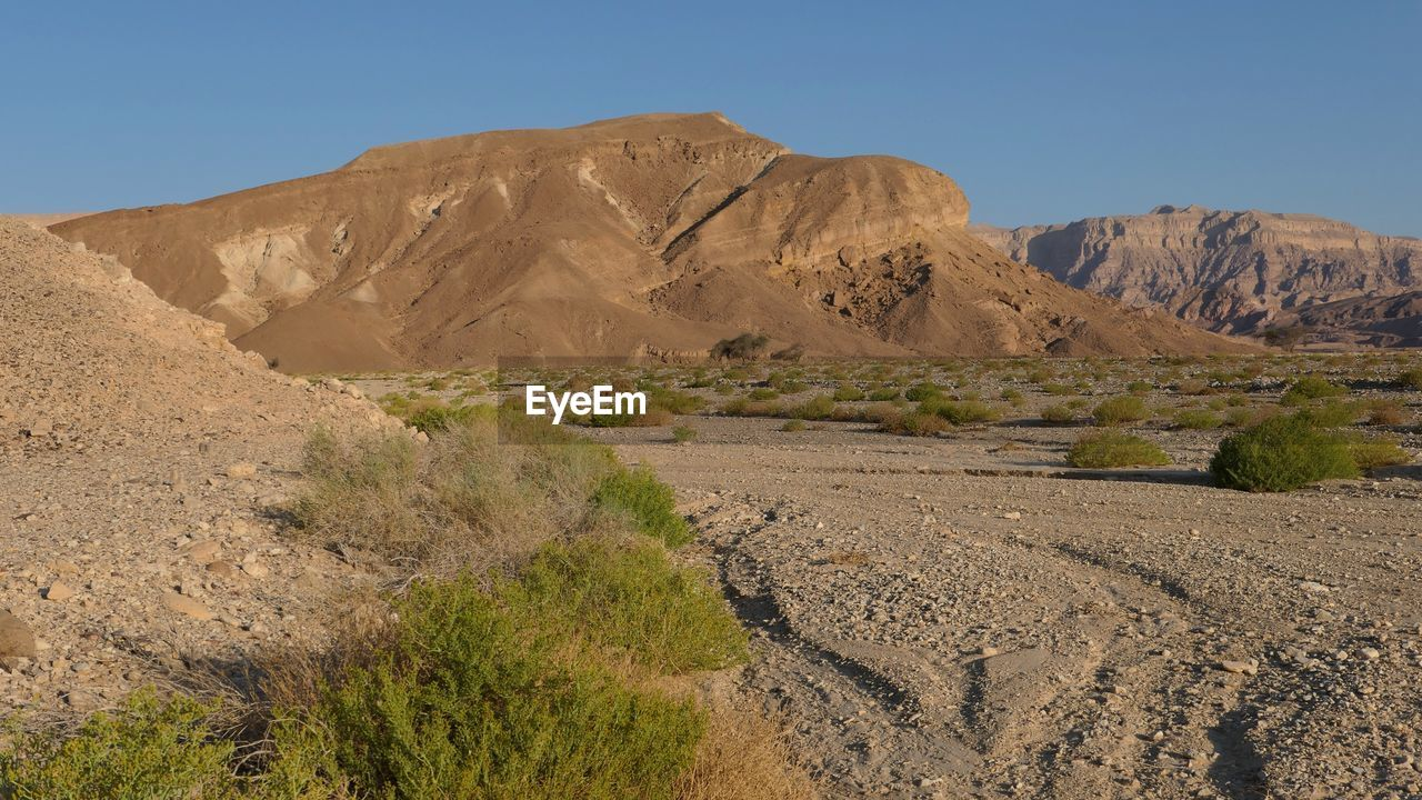 scenics - nature, tranquil scene, landscape, environment, beauty in nature, mountain, tranquility, sky, non-urban scene, nature, land, rock, desert, mountain range, no people, climate, physical geography, arid climate, rock formation, rock - object, formation, outdoors, eroded