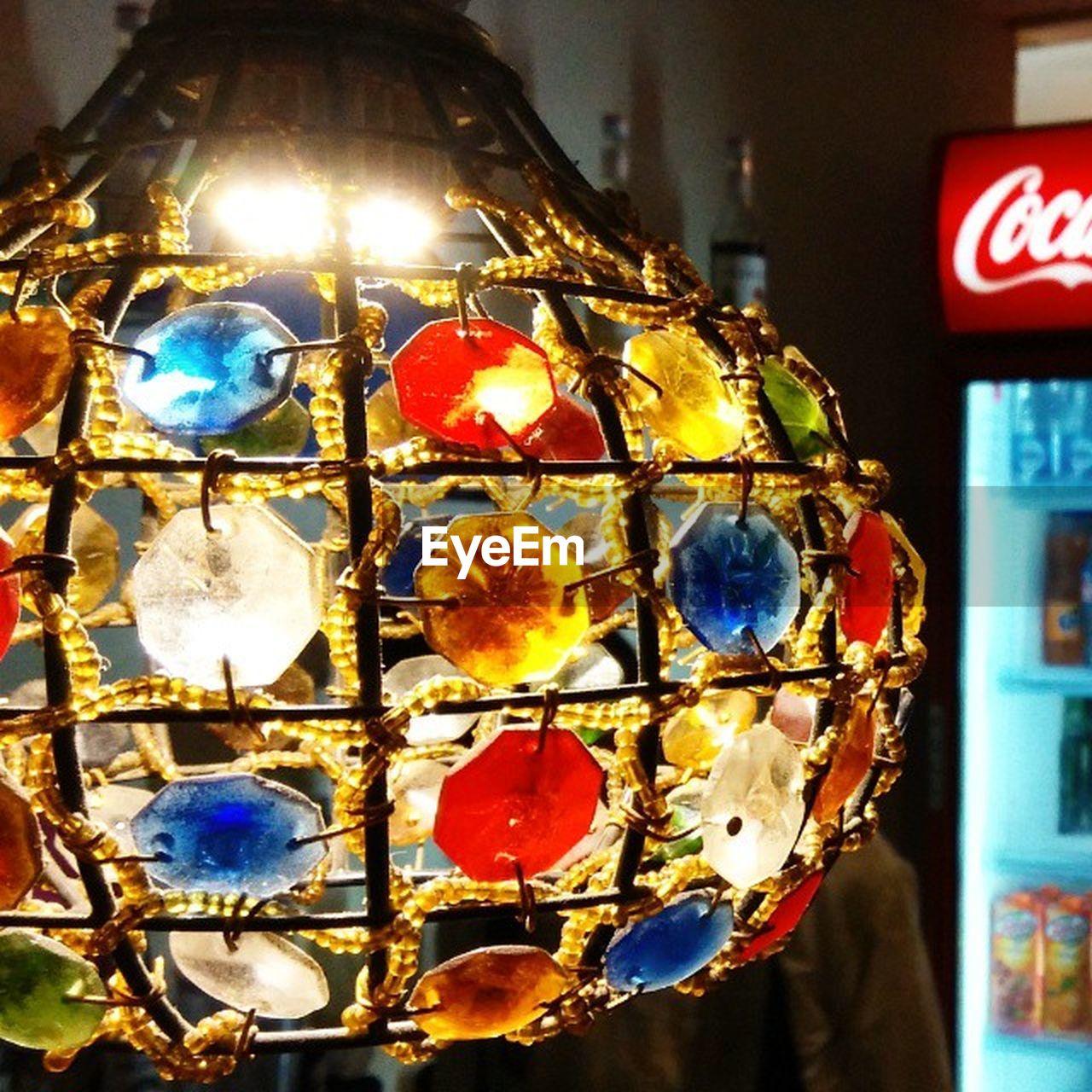 illuminated, close-up, lighting equipment, indoors, hanging, no people, focus on foreground, christmas decoration, night
