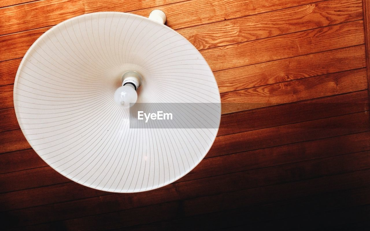 Low angle view of electric lamp