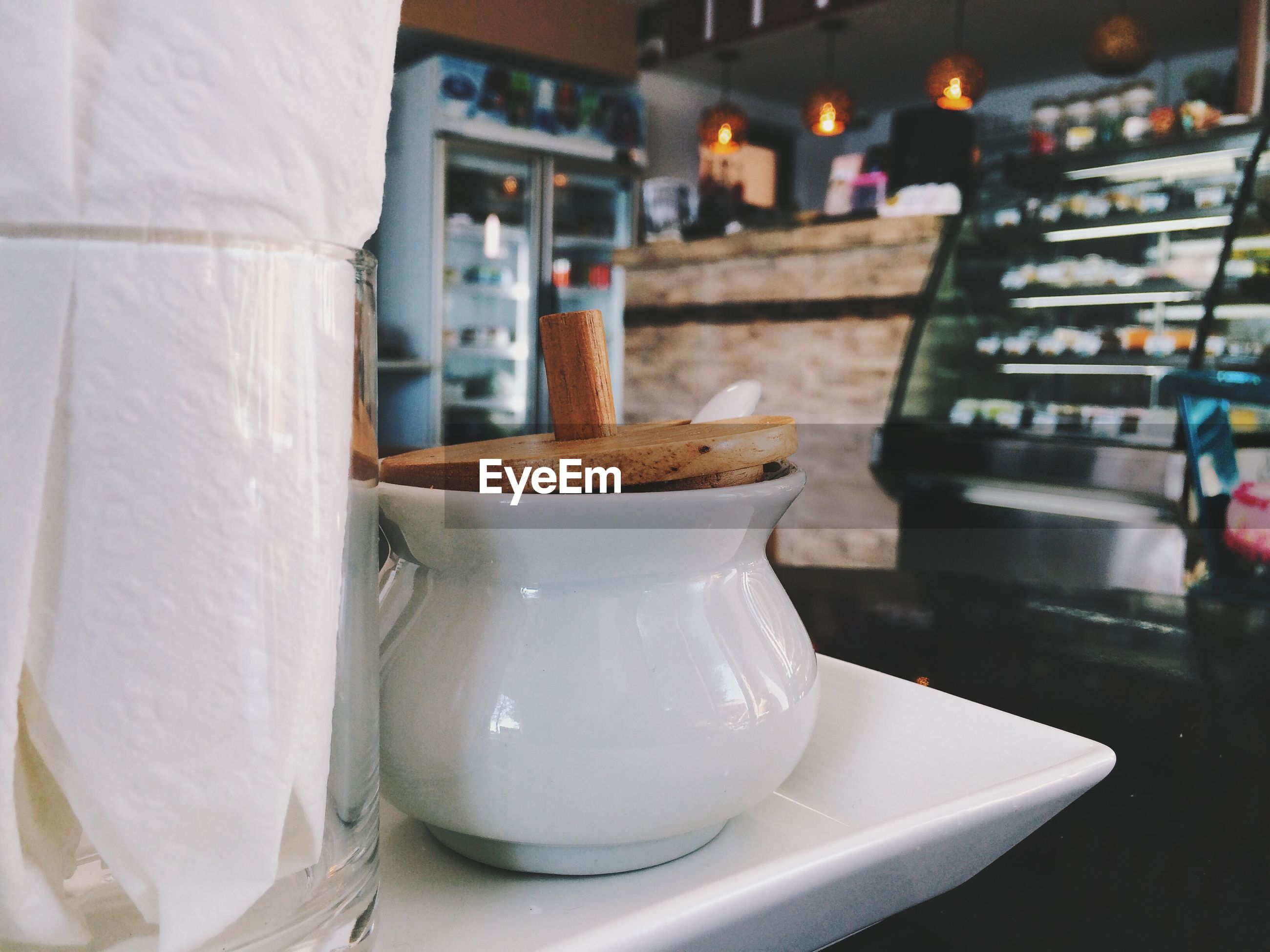 Coffee pot in plate on table at restaurant