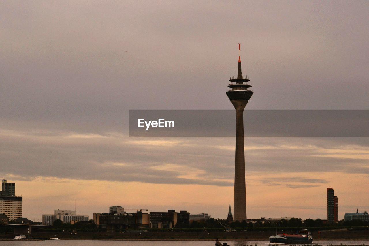 Rheinturm Against Cloudy Sky At Sunset