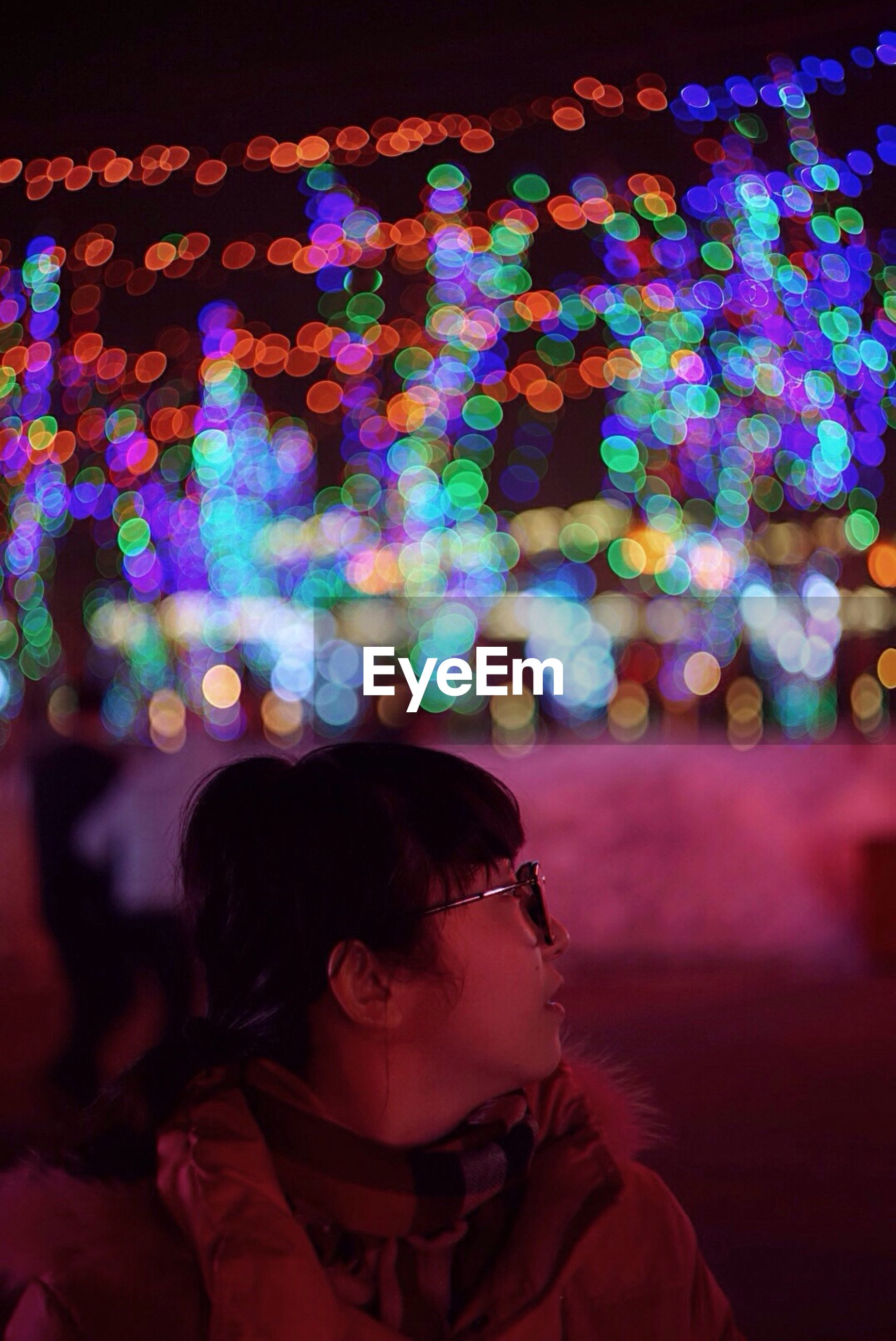 lifestyles, illuminated, leisure activity, night, rear view, person, indoors, standing, men, headshot, waist up, casual clothing, multi colored, blue, full length, celebration, built structure