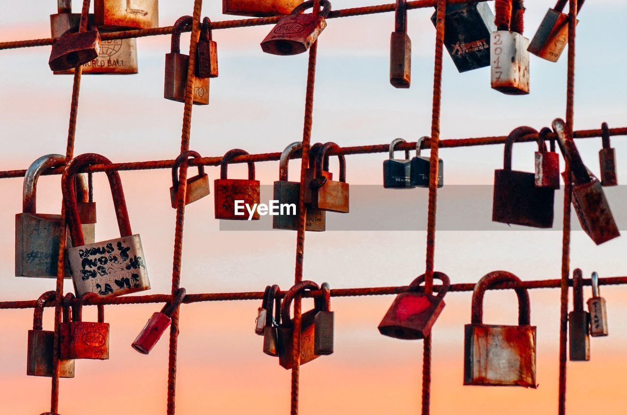padlock, lock, hanging, safety, protection, security, love lock, love, no people, close-up, hope - concept, abundance, hope, emotion, day, large group of objects, positive emotion, railing, luck, text, outdoors