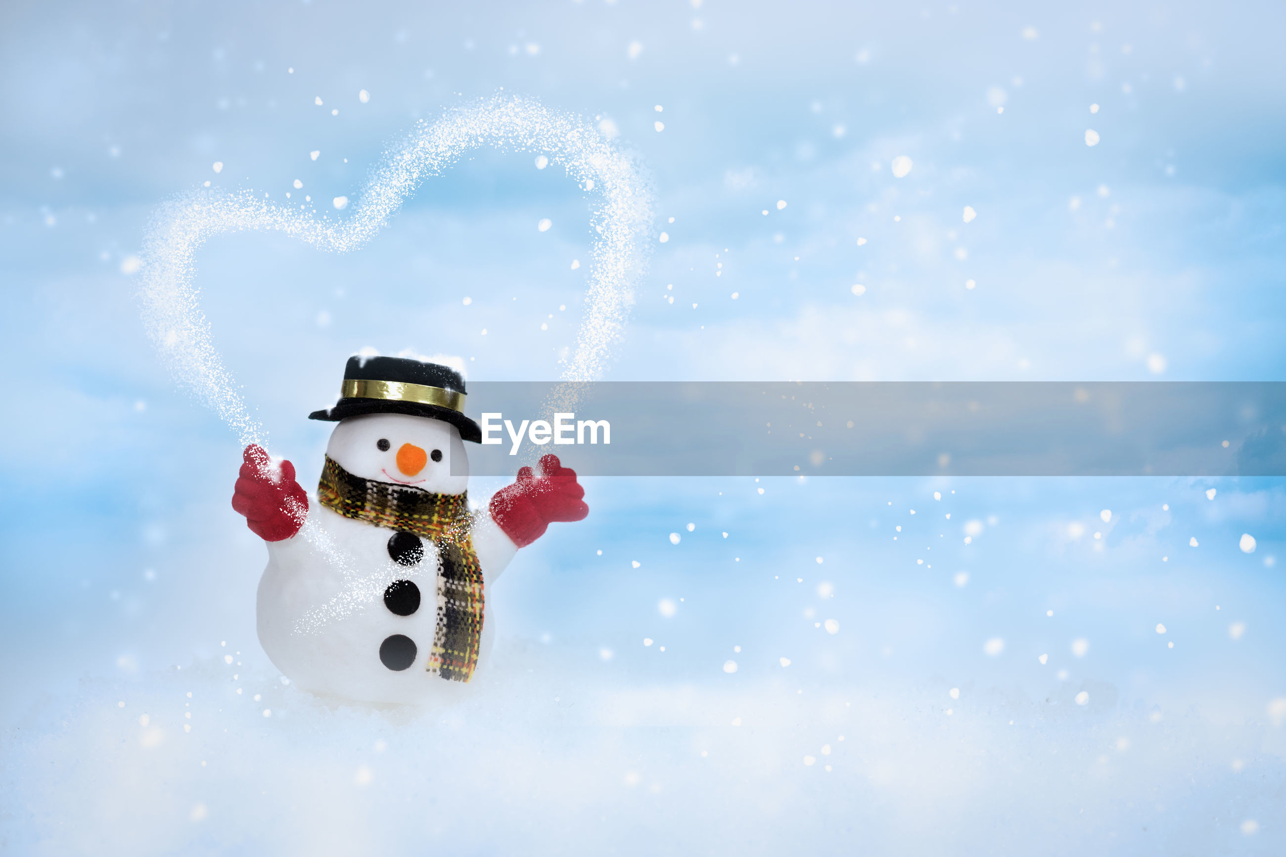 Close-up of snowman during winter