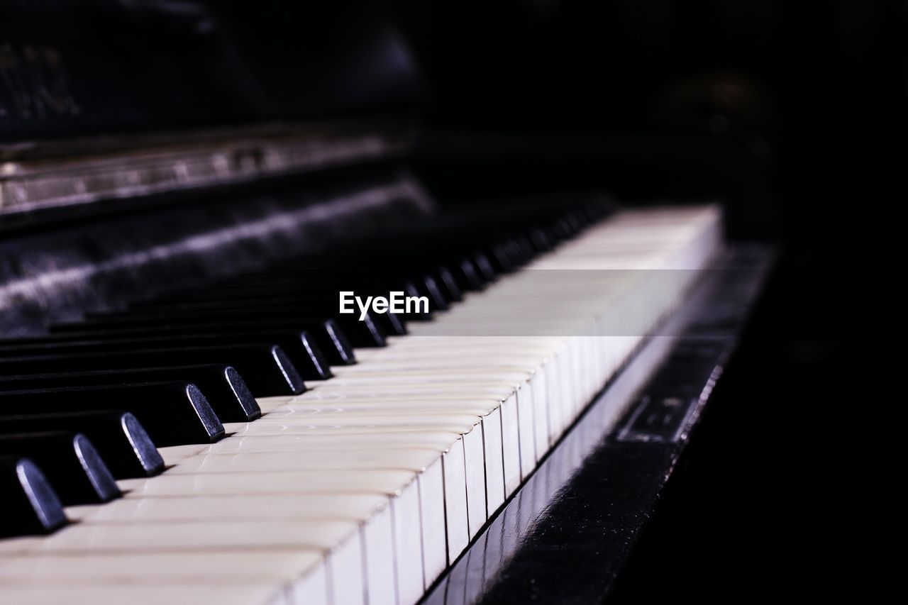 Close-Up Of Piano Keys Against Black Background