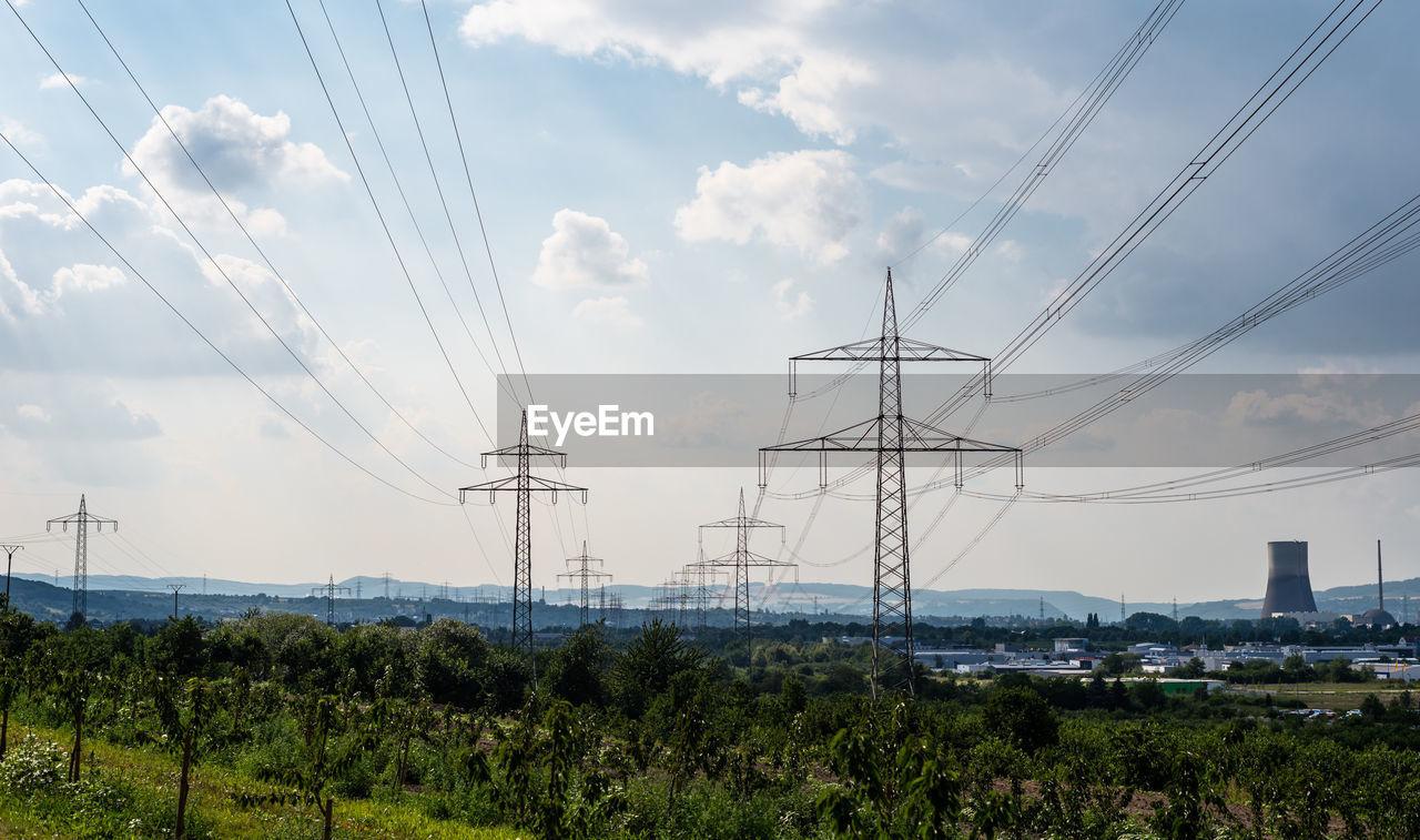 ELECTRICITY PYLON BY LAND AGAINST SKY