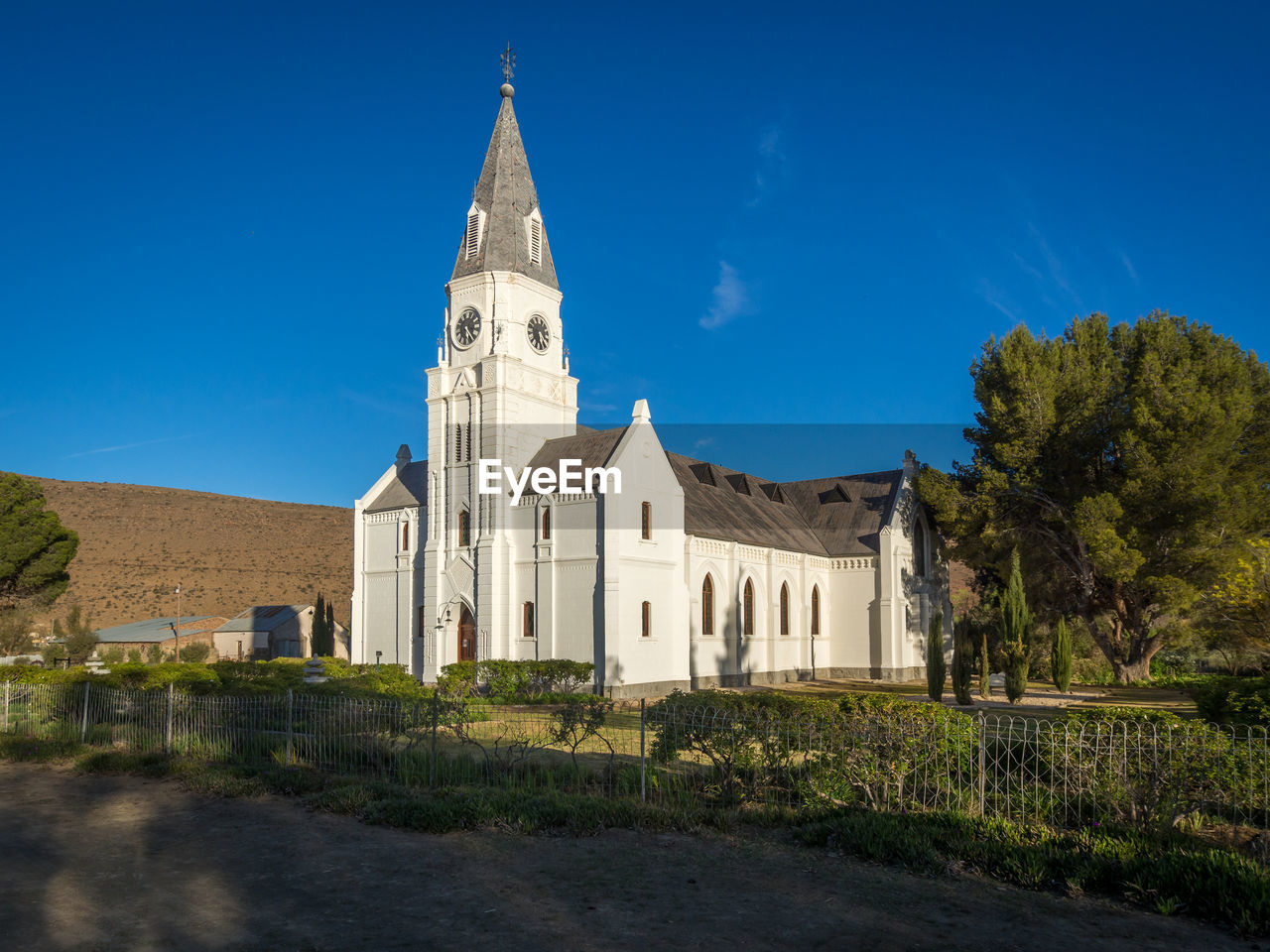 View Of White Dutch Reformed Church Against Blue Sky, Nieu-Bethesda, South Africa