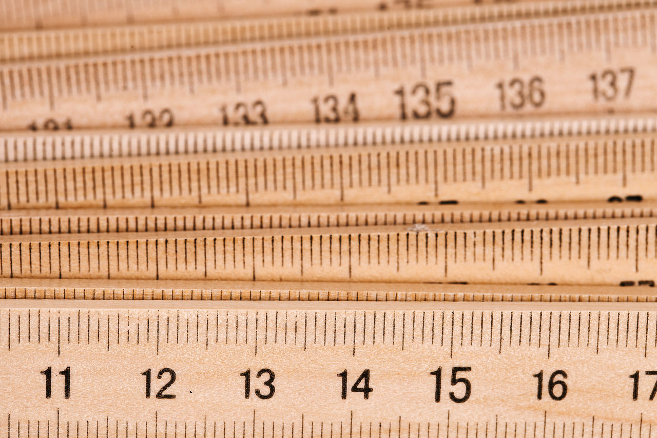 Close-Up Of Wooden Rulers