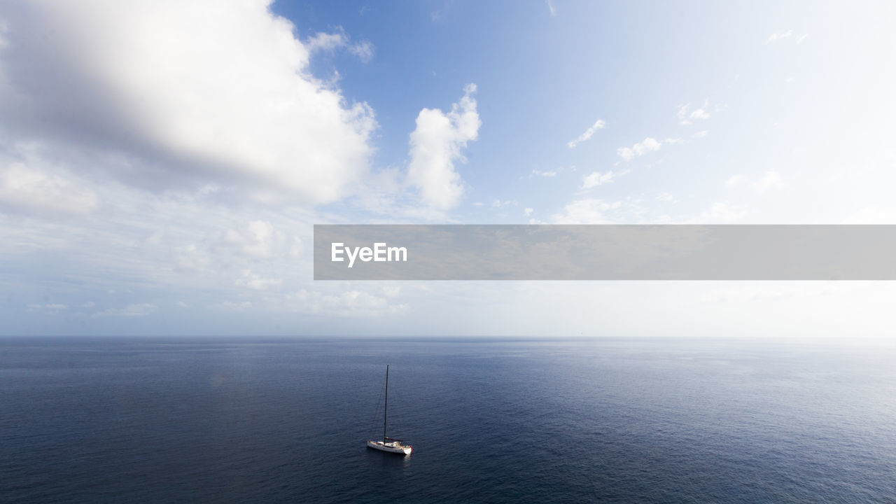 water, sea, sky, horizon over water, scenics - nature, cloud - sky, tranquil scene, beauty in nature, nautical vessel, horizon, tranquility, transportation, waterfront, no people, mode of transportation, day, idyllic, nature, seascape, sailboat, luxury, yacht