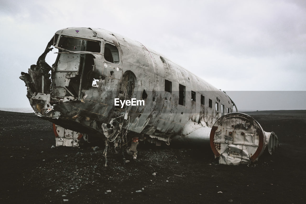 ABANDONED AIRPLANE ON AIRPORT RUNWAY