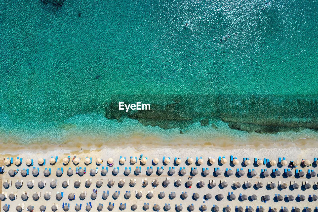 Aerial View Of Sea And Lounge Chairs