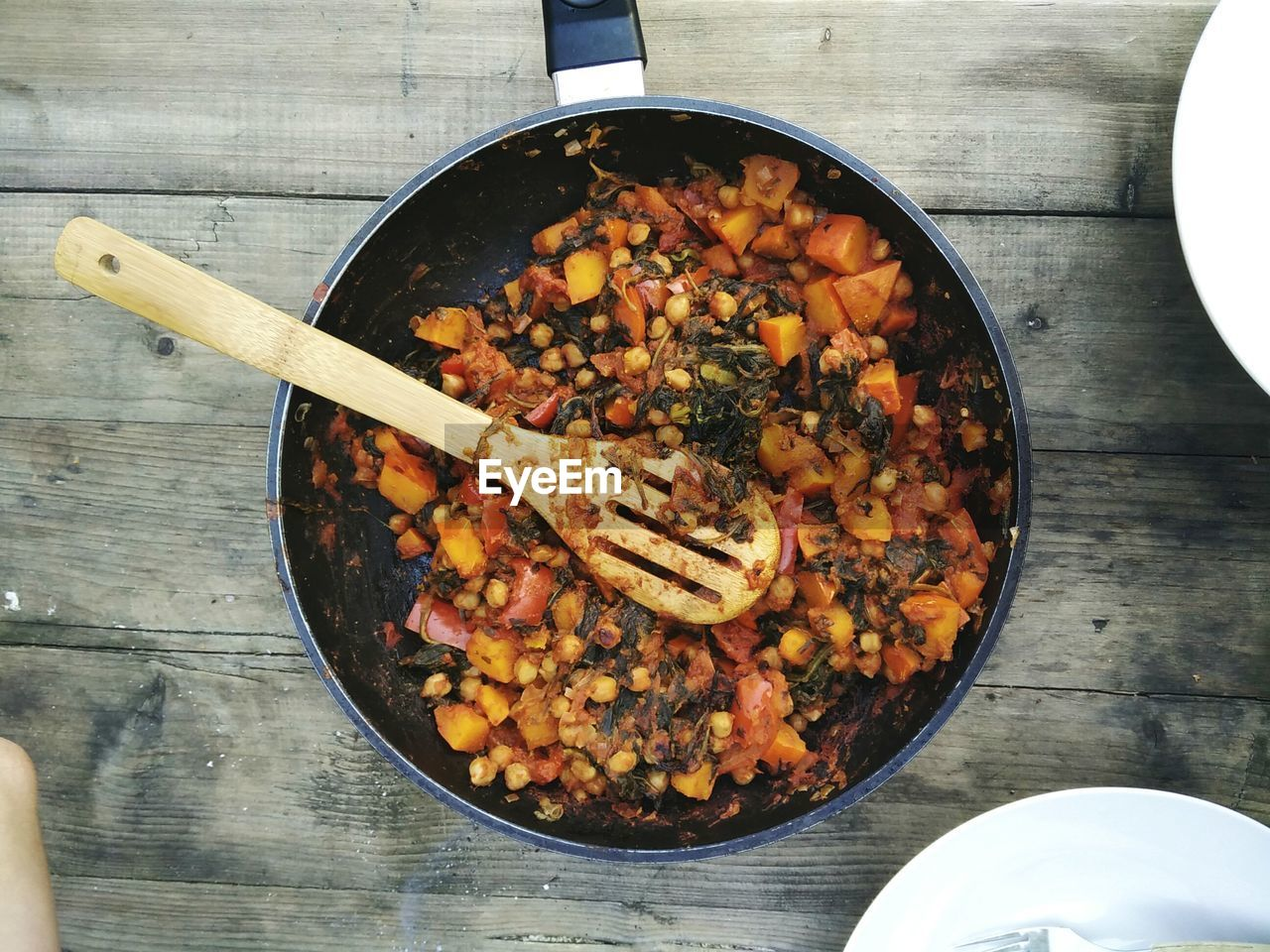 Directly Above View Of Pumpkin Curry With Chick Peas And Spinach In Pan