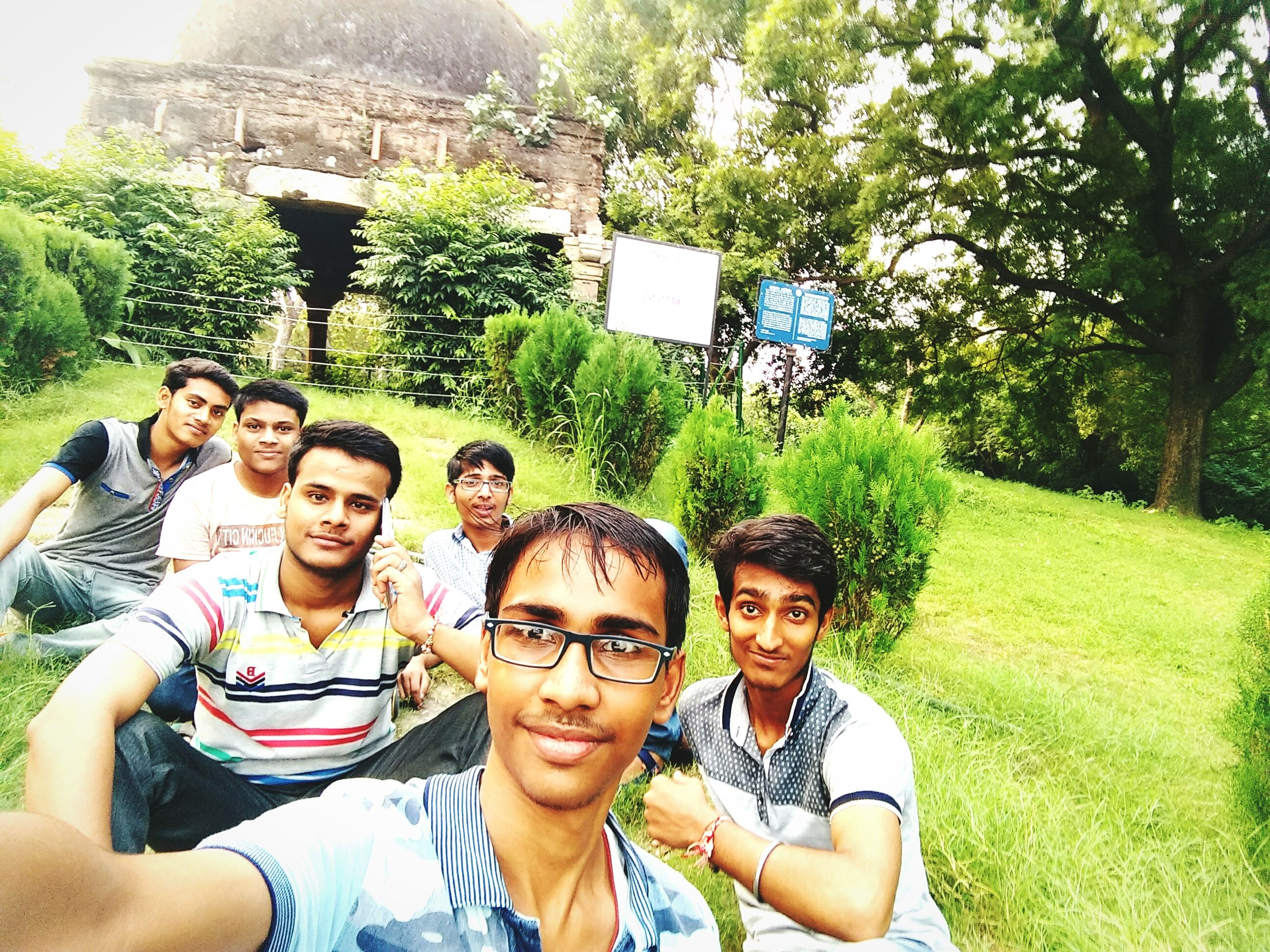 togetherness, tree, bonding, friendship, young women, love, leisure activity, young adult, standing, lifestyles, casual clothing, looking at camera, plant, front view, green color, person, day, park, looking, weekend activities, outdoors, friends