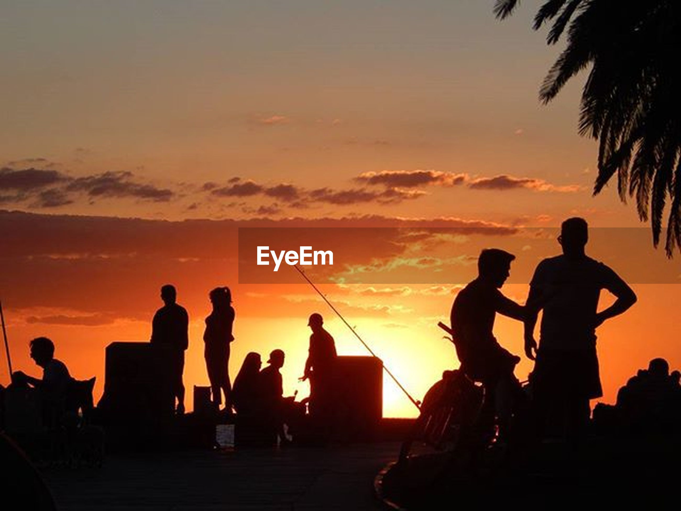 silhouette, sunset, men, orange color, sky, lifestyles, togetherness, leisure activity, person, large group of people, outline, medium group of people, cloud - sky, sitting, nature, group of people, outdoors, dark, cloud