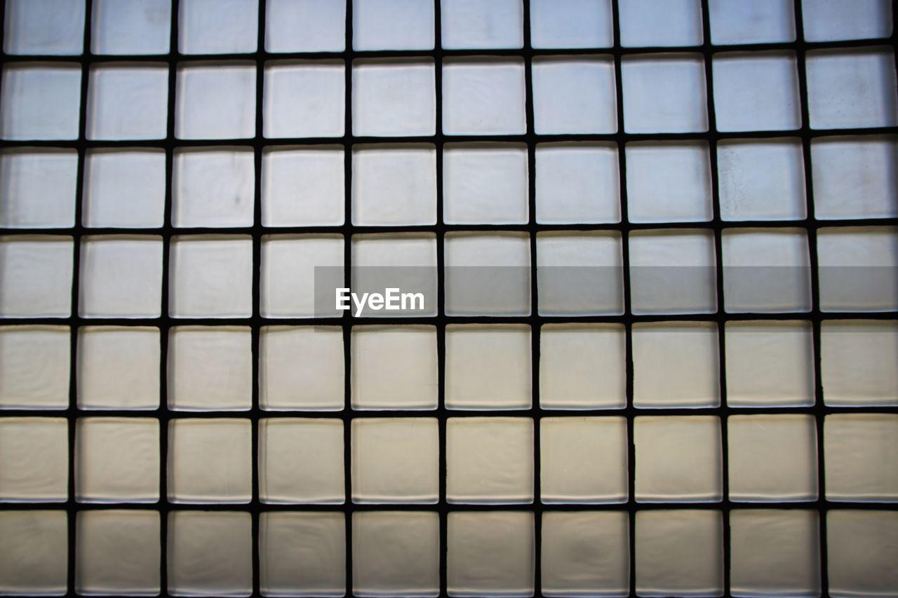 Full Frame Shot Of Patterned Glass Wall