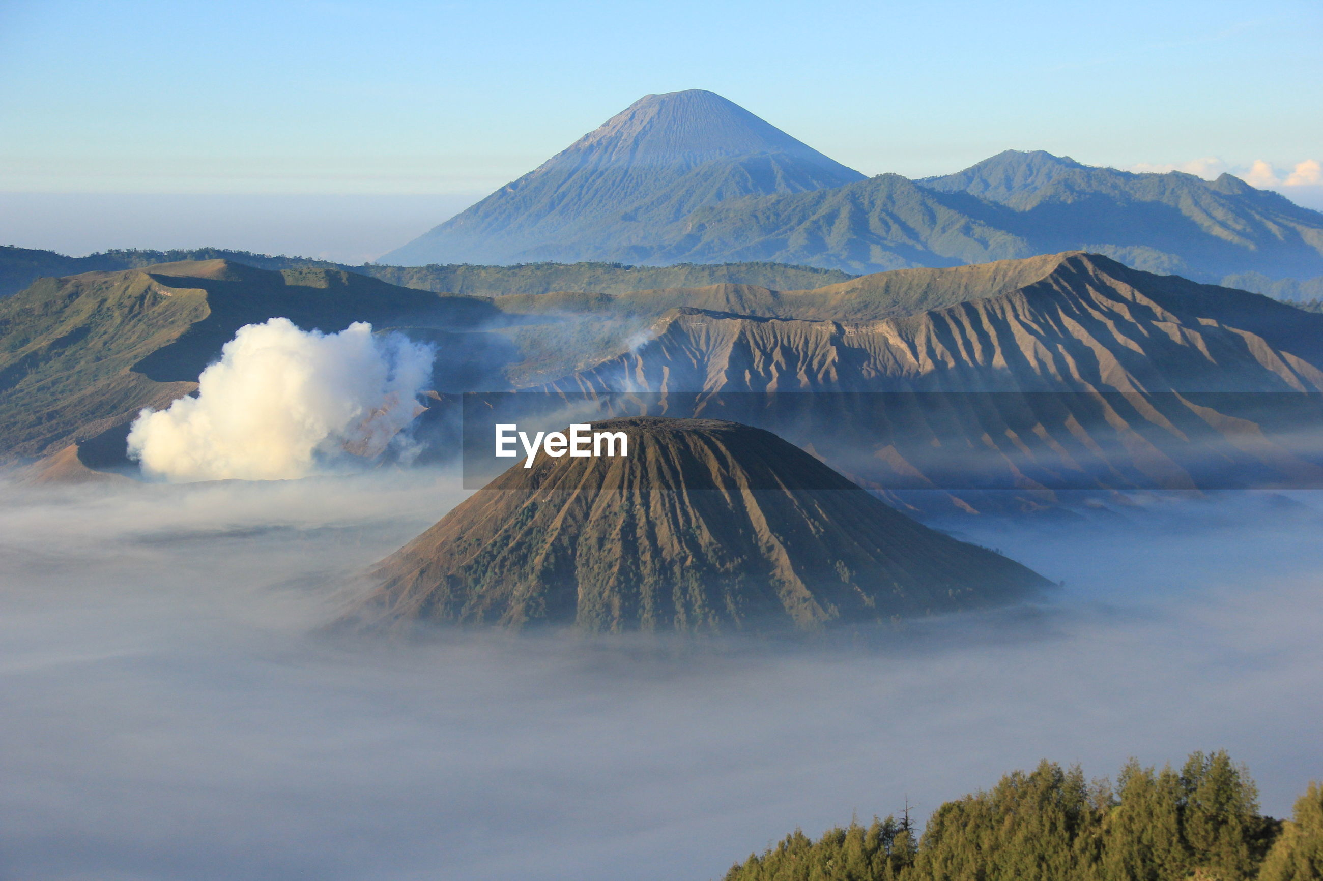 High angle view of volcanic mountains against sky