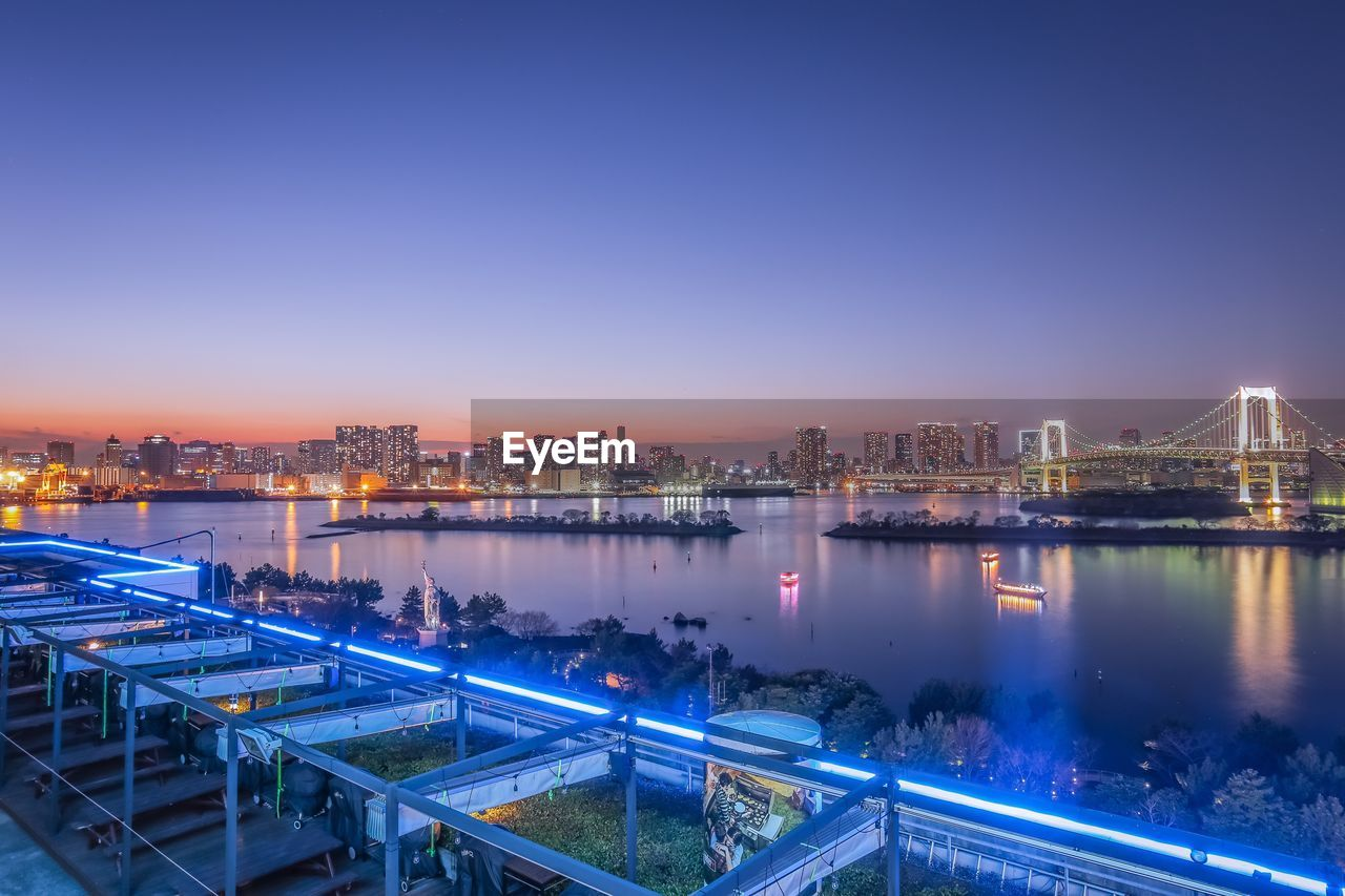 building exterior, architecture, sky, built structure, water, illuminated, city, copy space, nature, river, transportation, connection, high angle view, no people, cityscape, night, bridge - man made structure, outdoors, bridge