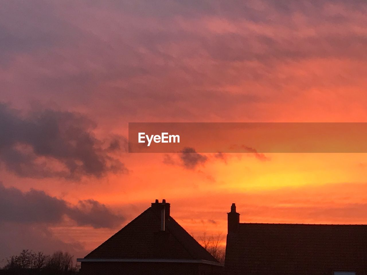 sunset, architecture, sky, built structure, building exterior, cloud - sky, building, orange color, silhouette, nature, roof, beauty in nature, house, scenics - nature, no people, dramatic sky, outdoors, residential district, idyllic, romantic sky